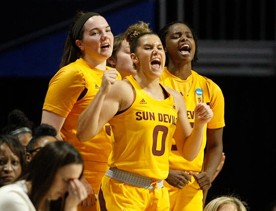 Arizona State guard Taya Hanson (0) leads the bench in cheering for her team, during a first round women's college basketball game against UCF, in the NCAA Tournament in Friday, March 22, 2019, in Coral Gables, Fla.