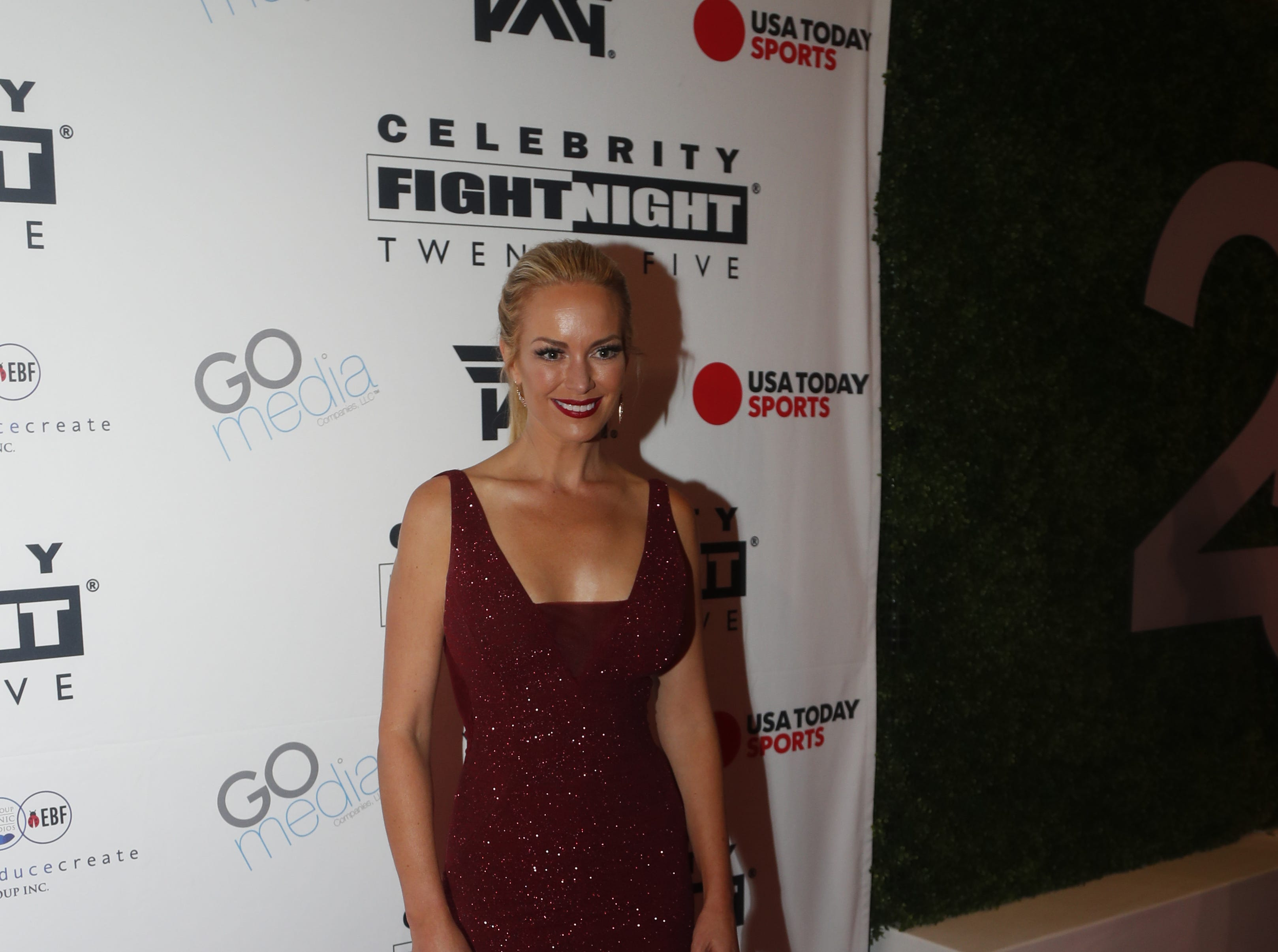 Caroline Campbell poses for pictures during the Celebrity Fight Night red carpet in Scottsdale, Ariz., on March 23, 2019.