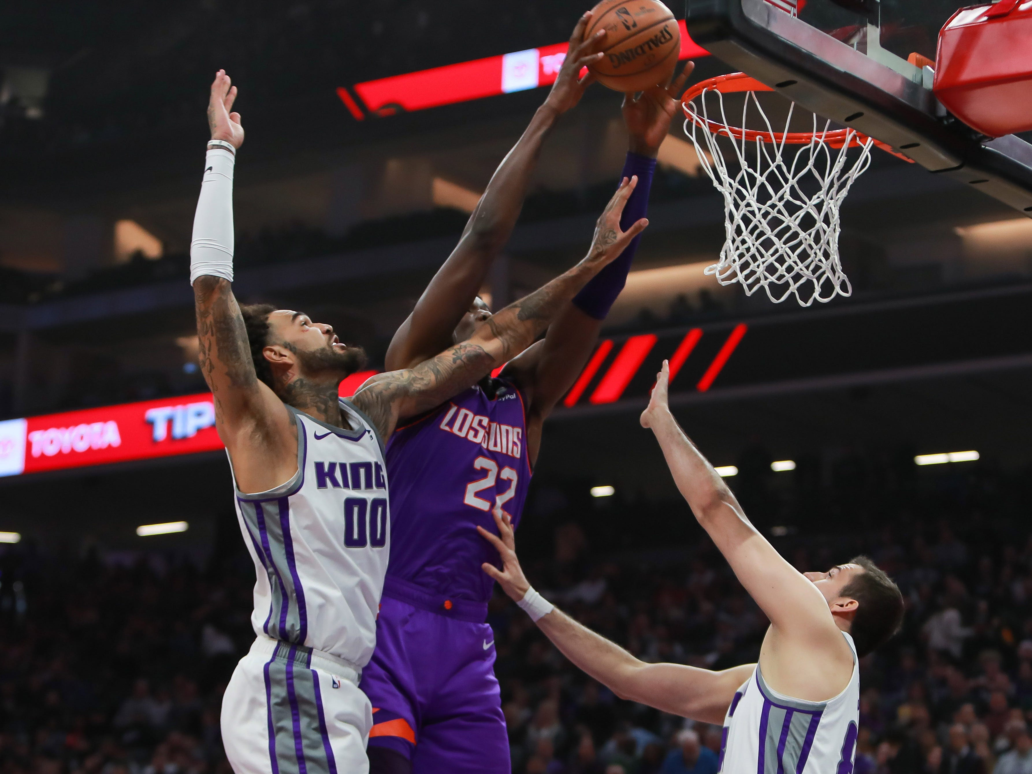 Mar 23, 2019; Sacramento, CA, USA; Phoenix Suns center Deandre Ayton (22) dunks the ball over Sacramento Kings forward Nemanja Bjelica (88) during the first quarter at Golden 1 Center.