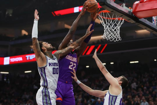Suns center Deandre Ayton dunks the ball during a game against the Kings on March 23.