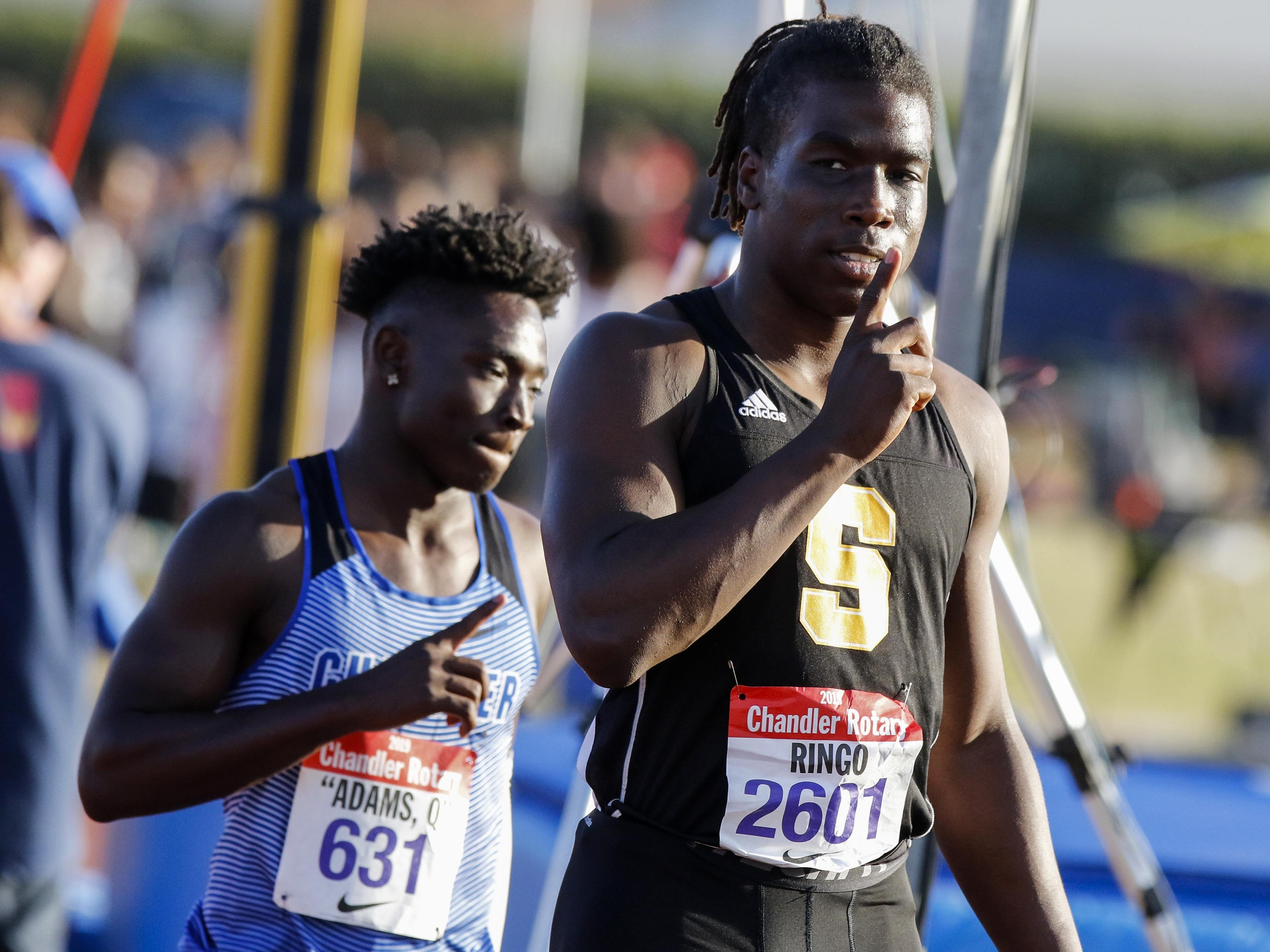 Saguaro's Kelee Ringo gestures #1 after winning the 100 meters 10.43 during the 79th Annual Nike Chandler Rotary Invitational  March 23, 2019.