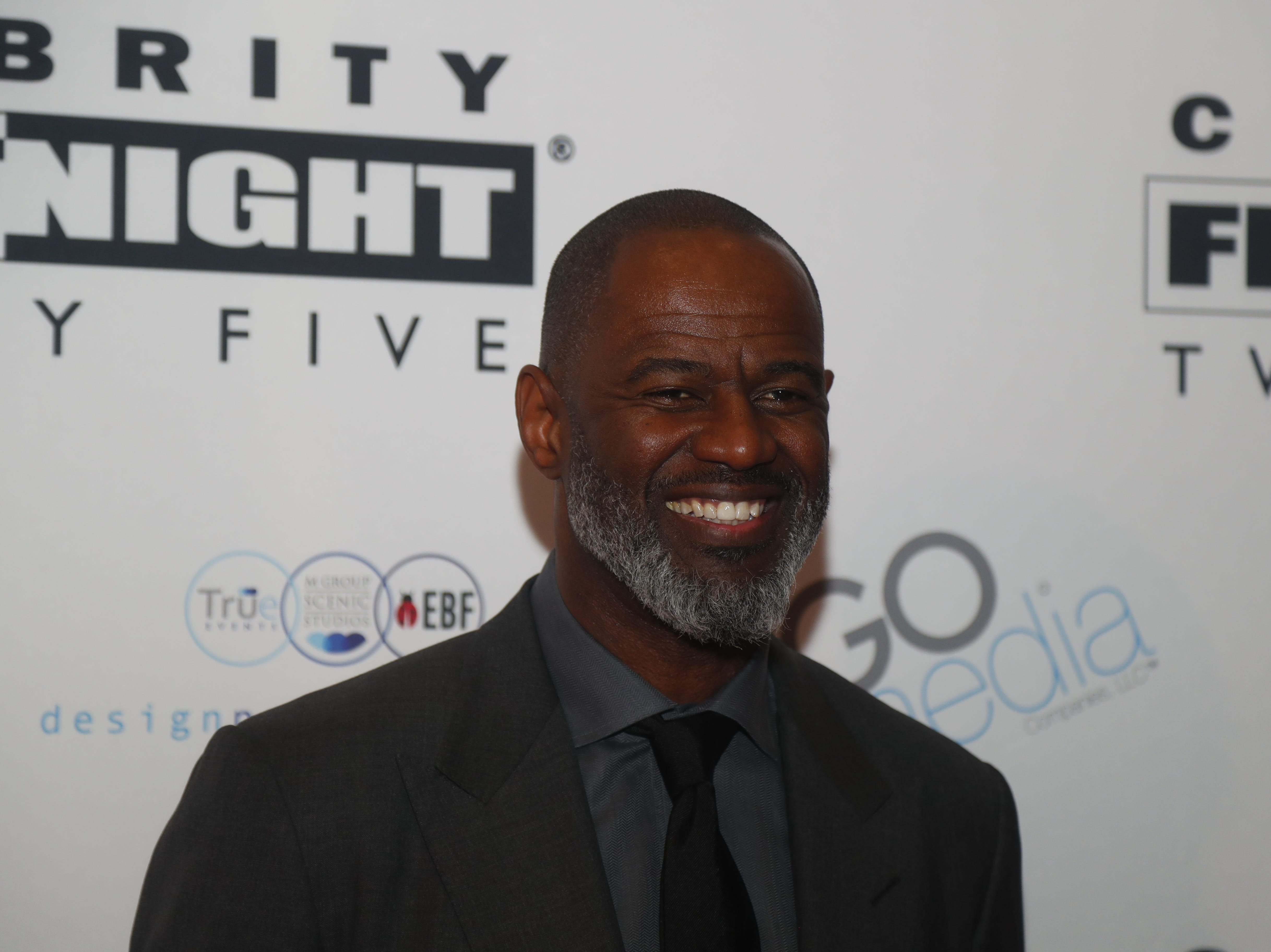Brian McKnight poses for pictures during the Celebrity Fight Night red carpet in Scottsdale, Ariz., on March 23, 2019.