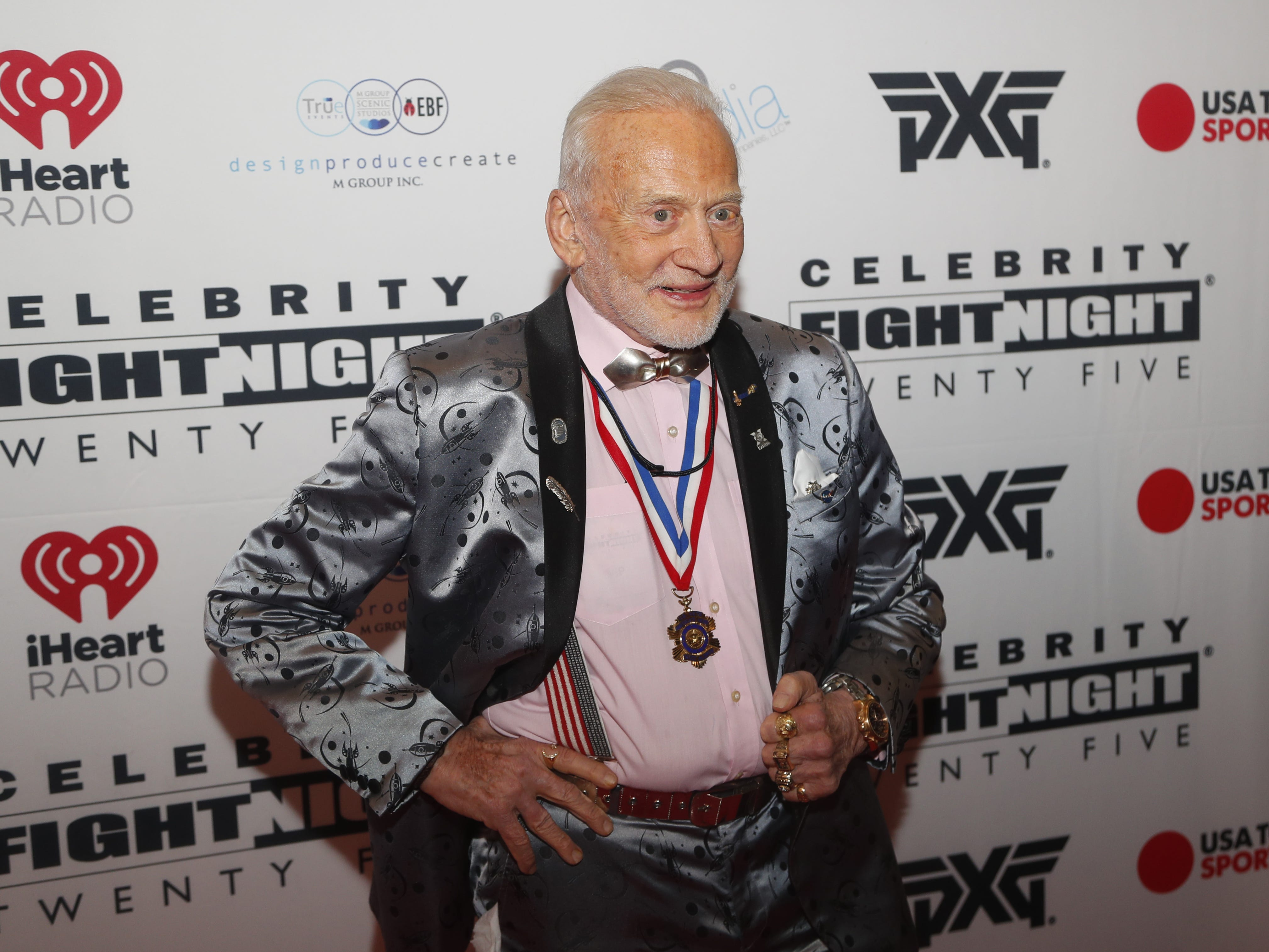 Buzz Aldrin poses for pictures during the Celebrity Fight Night red carpet in Scottsdale, Ariz., on March 23, 2019.