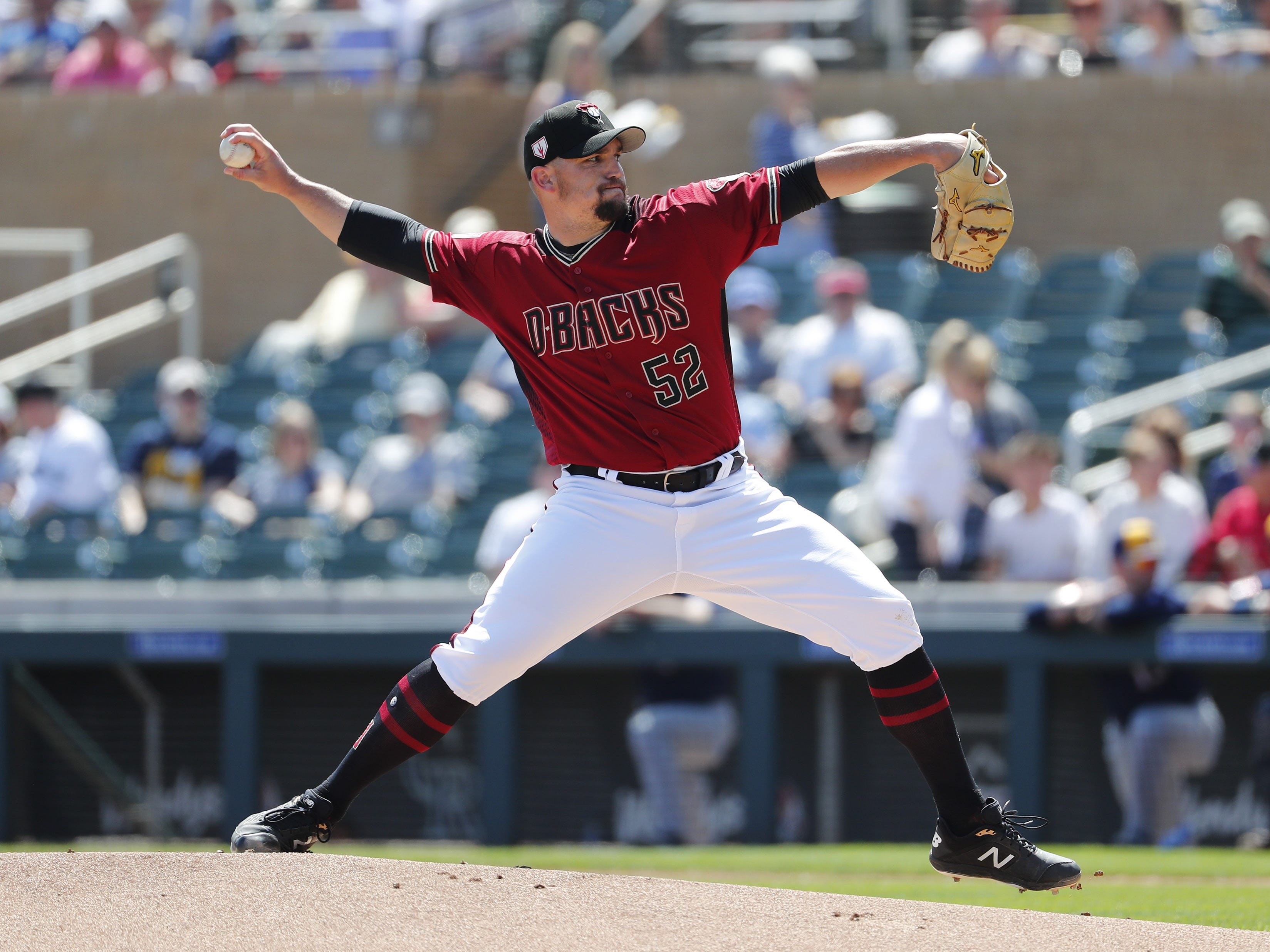 Arizona Diamondbacks starting pitcher Zack Godley (52) throws against the Milwaukee Brewers during spring training at Salt River Fields at Talking Stick March 24, 2019.