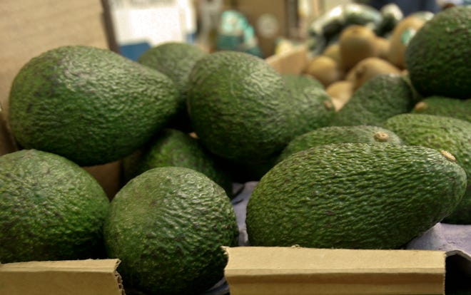 """In this 2007 file photo, California-grown avocados are for sale at a market in California. Henry Avocado, a grower and distributor based near San Diego is voluntarily recalling their California grown """"Henry"""" labeled whole avocados over possible listeria contamination."""