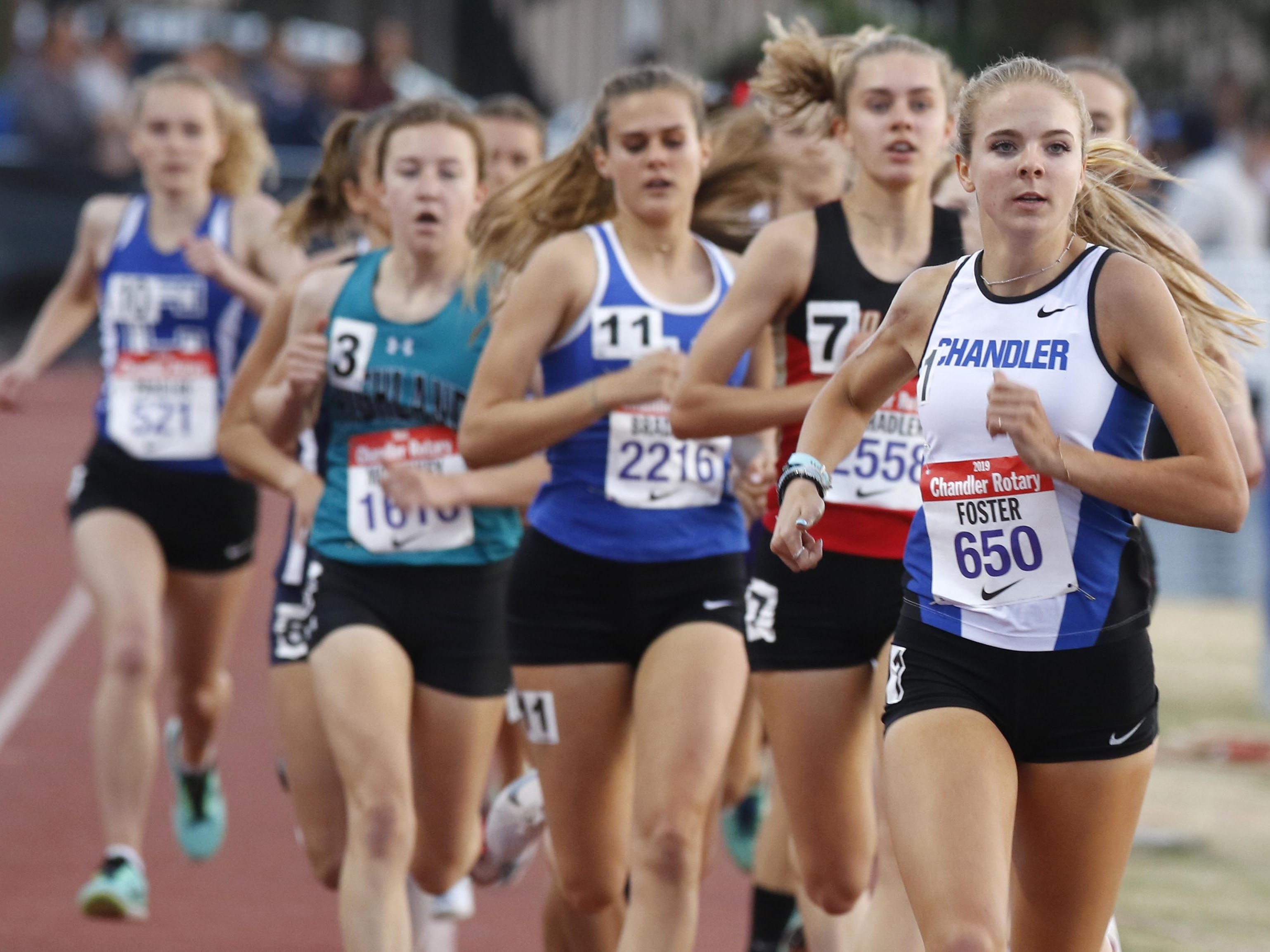 Chandler's Morgan Foster leads the pack after the first lap of the mile run during the 79th Annual Nike Chandler Rotary Invitational  March 23, 2019.