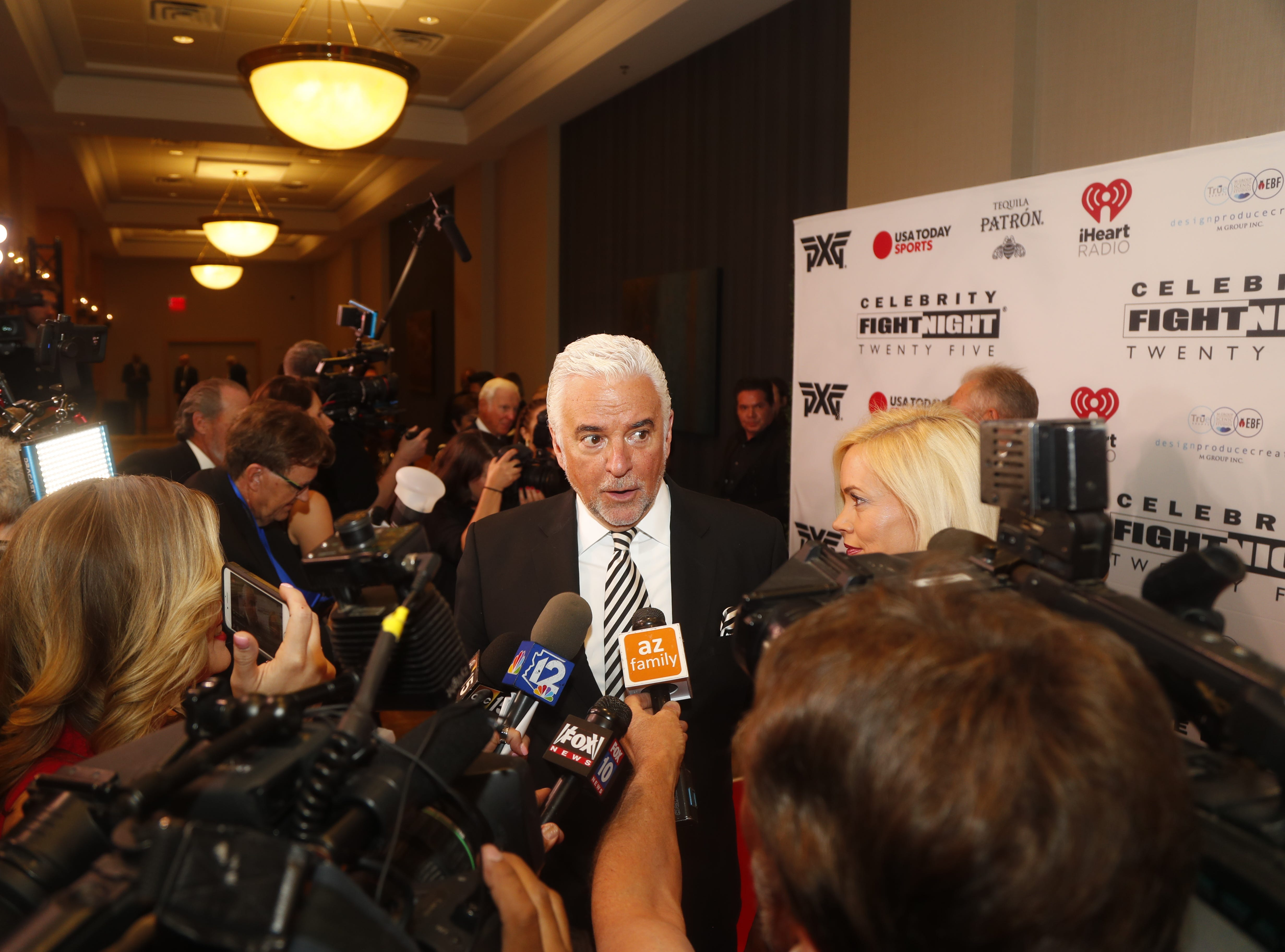 John O'Hurley speaks with the media during the Celebrity Fight Night red carpet in Scottsdale, Ariz., on March 23, 2019.