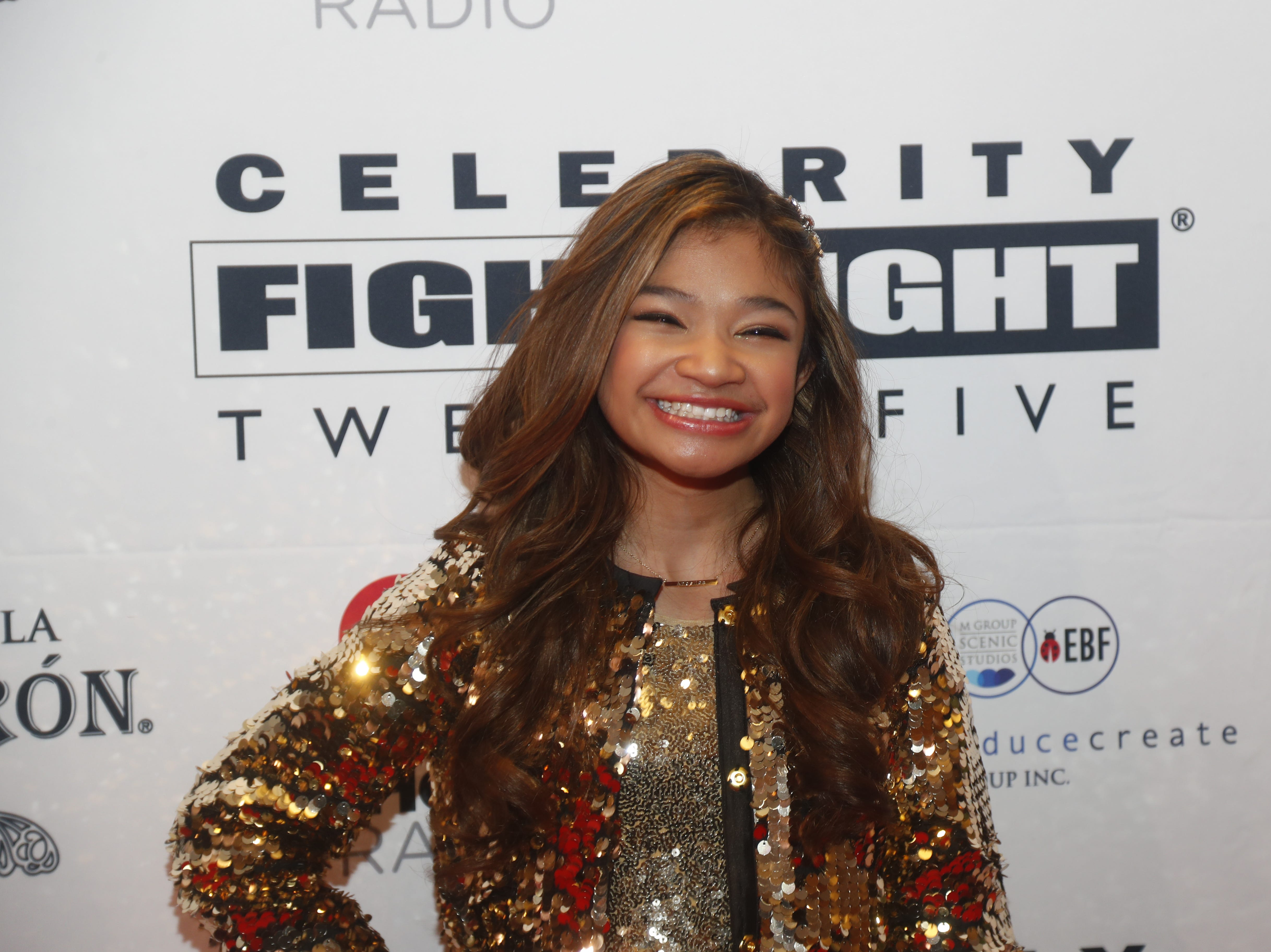 Angelica Hale poses for pictures during the Celebrity Fight Night red carpet in Scottsdale, Ariz., on March 23, 2019.