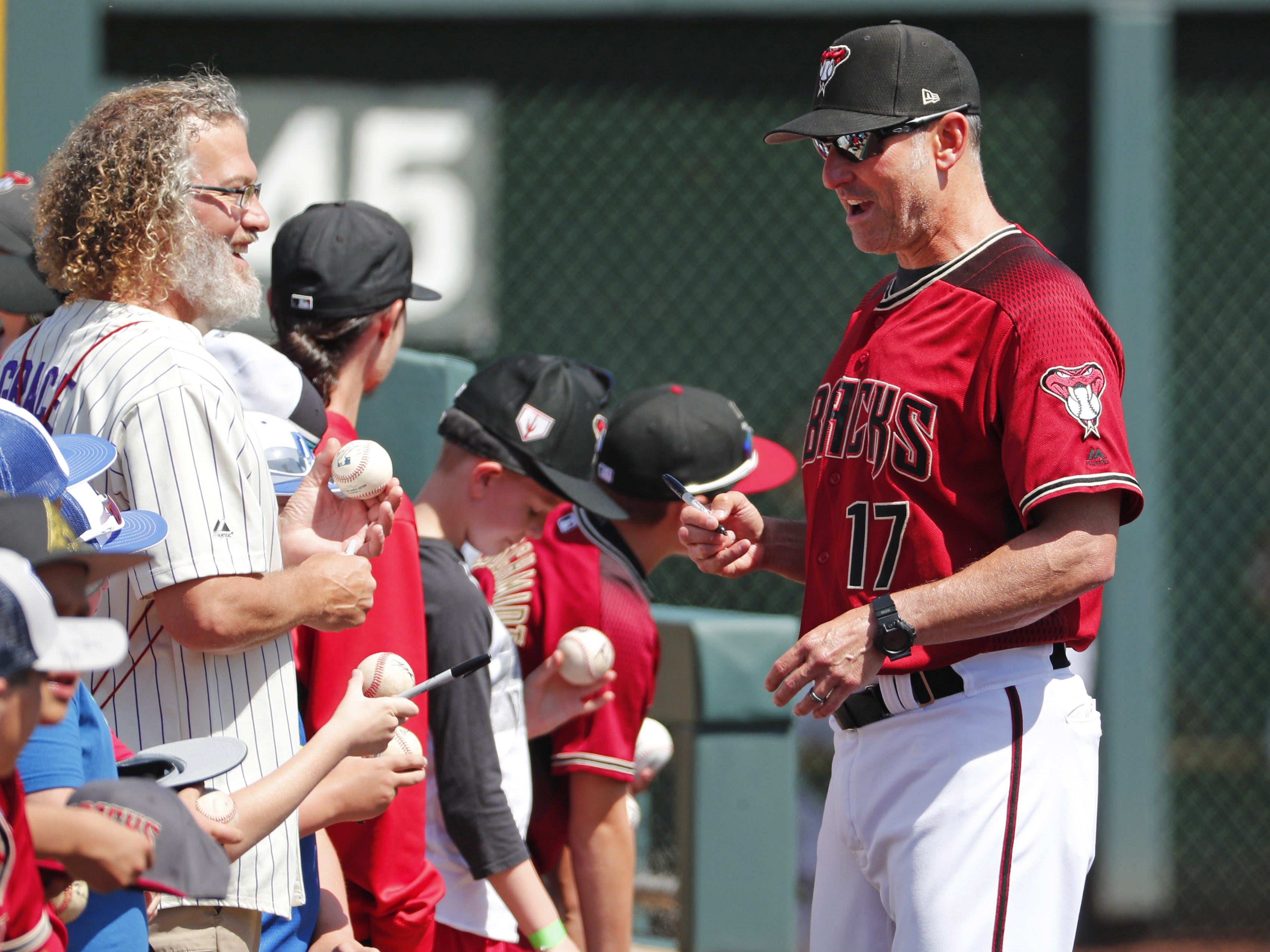 Arizona Diamondbacks manager Torey Lovullo (17) signs autographs before a spring training game against the Milwaukee Brewers at Salt River Fields at Talking Stick March 24, 2019.