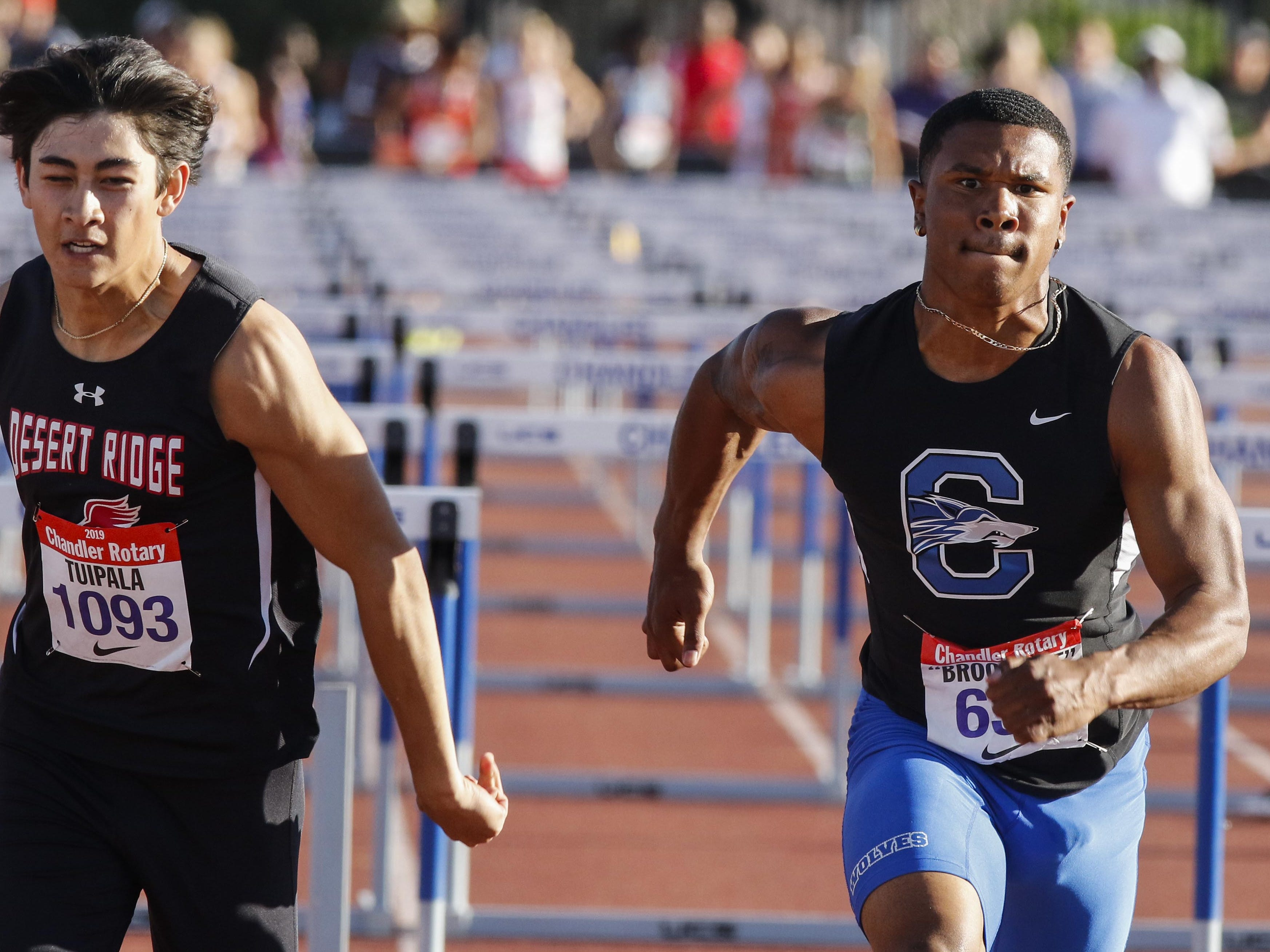 Desert Ridge's Koa Tuipala edges Chandlerr's DeCarlos Brooks in the 110 Boy's High Hurdles during the 79th Annual Nike Chandler Rotary Invitational  March 23, 2019.  Tuipala won the event in 14.30 over Brooks' 14.31.