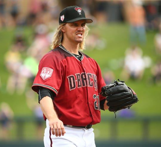Diamondbacks pitcher Zack Greinke warms-up as he prepares to throw to the Cleveland Indians in the first inning during a spring training game on Mar. 7, 2019 at Salt River Fields in Scottsdale, Ariz.
