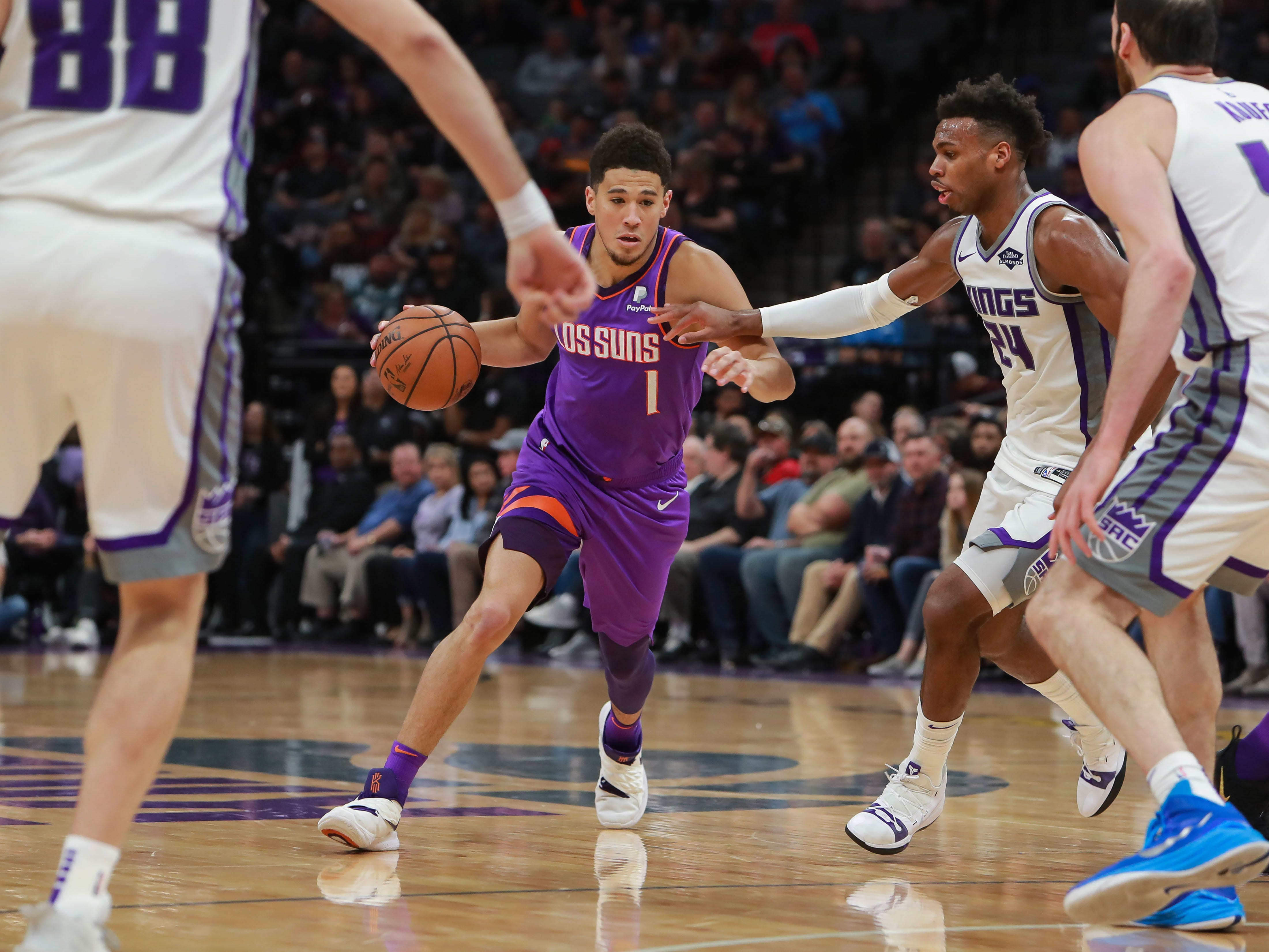 Mar 23, 2019; Sacramento, CA, USA; Phoenix Suns guard Devin Booker (1) dribbles the ball against Sacramento Kings guard Buddy Hield (24) during the second quarter at Golden 1 Center.