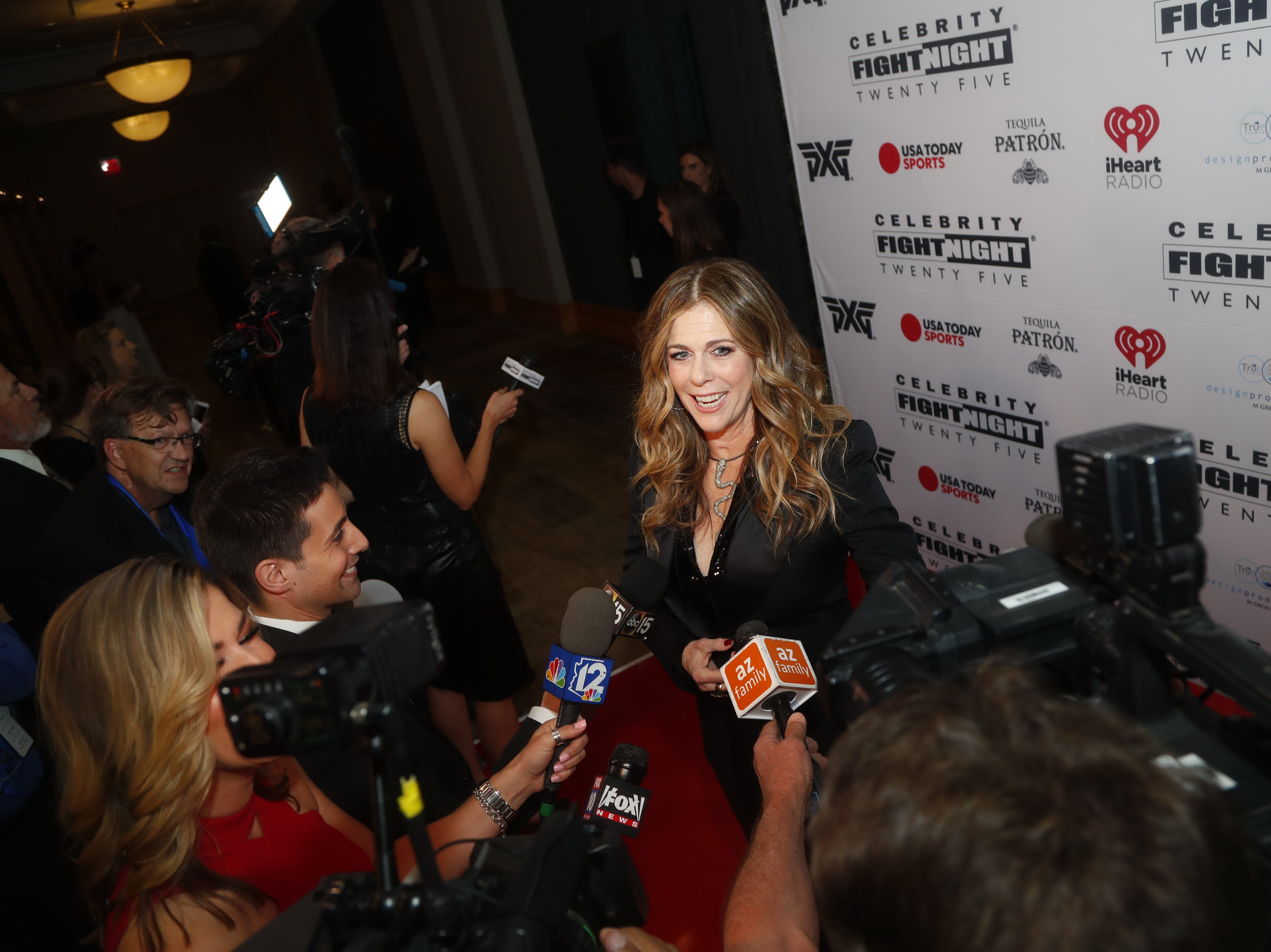 Rita Wilson talks to the media during the Celebrity Fight Night red carpet in Scottsdale, Ariz., on March 23, 2019.