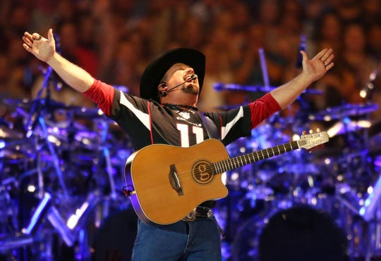 Country music legend Garth Brooks performs to over 75,000 fans, the largest indoor concert crowd ever in Arizona at State Farm Stadium on Mar. 23, 2019 in Glendale, Ariz.