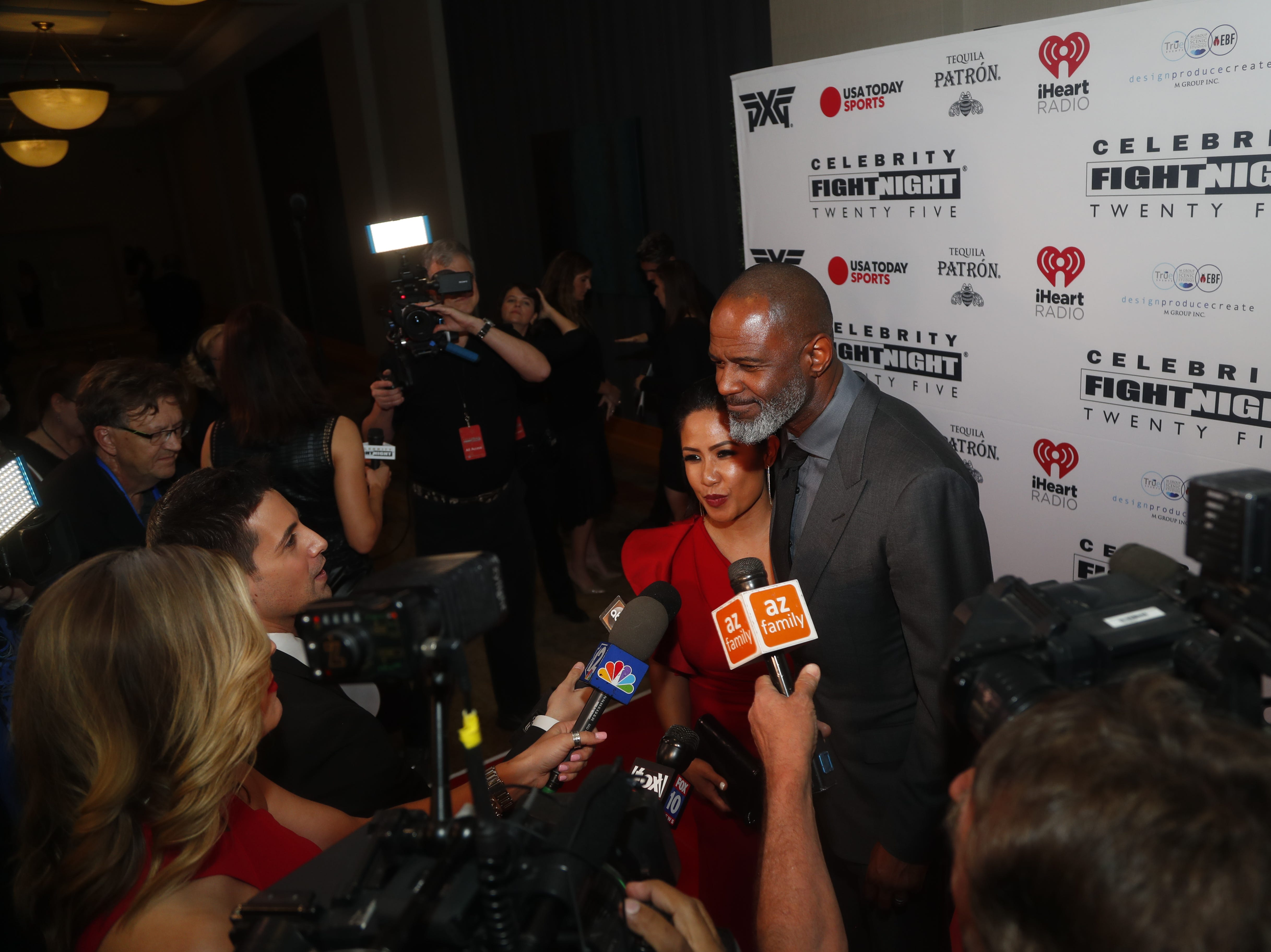 Brian McKnight answers questions from the media during the Celebrity Fight Night red carpet in Scottsdale, Ariz., on March 23, 2019.