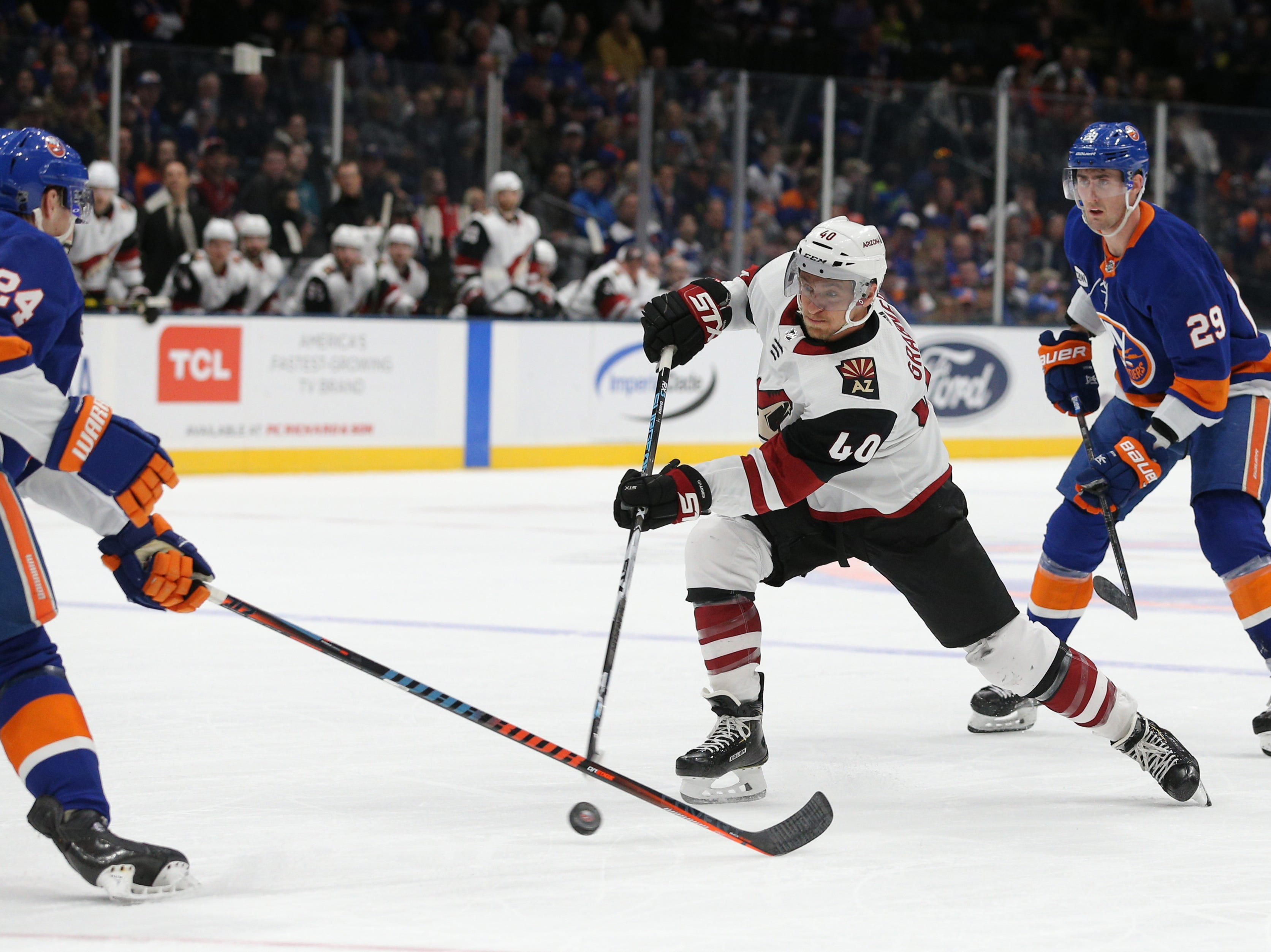 Coyotes right wing Michael Grabner (40) rips a shot past Islanders defenseman Scott Mayfield (24) during the first period of a game at Nassau Veterans Memorial Coliseum.