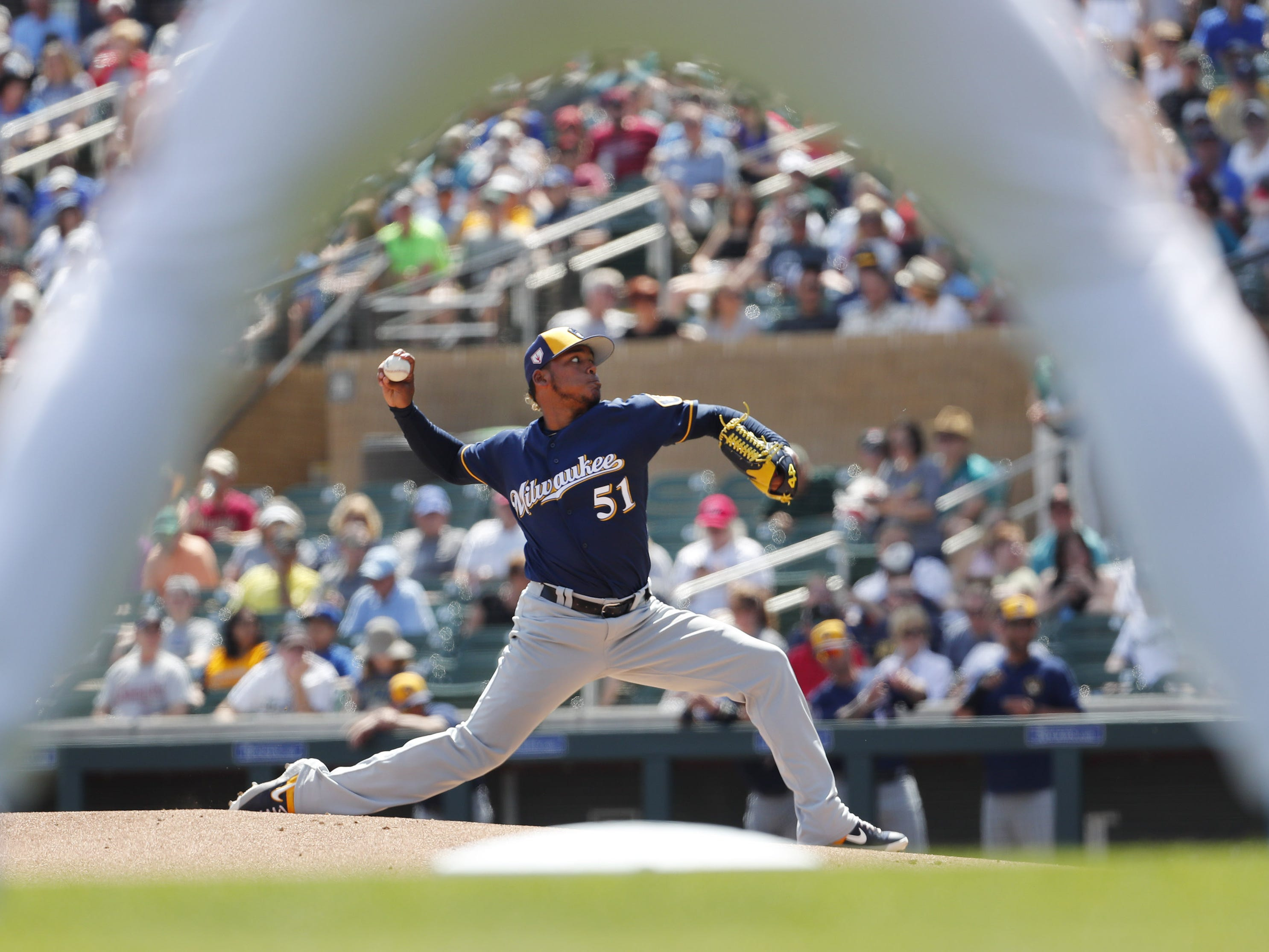 Milwaukee Brewers starting pitcher Freddy Peralta (51) throws against the Arizona Diamondbacks during spring training at Salt River Fields at Talking Stick March 24, 2019.