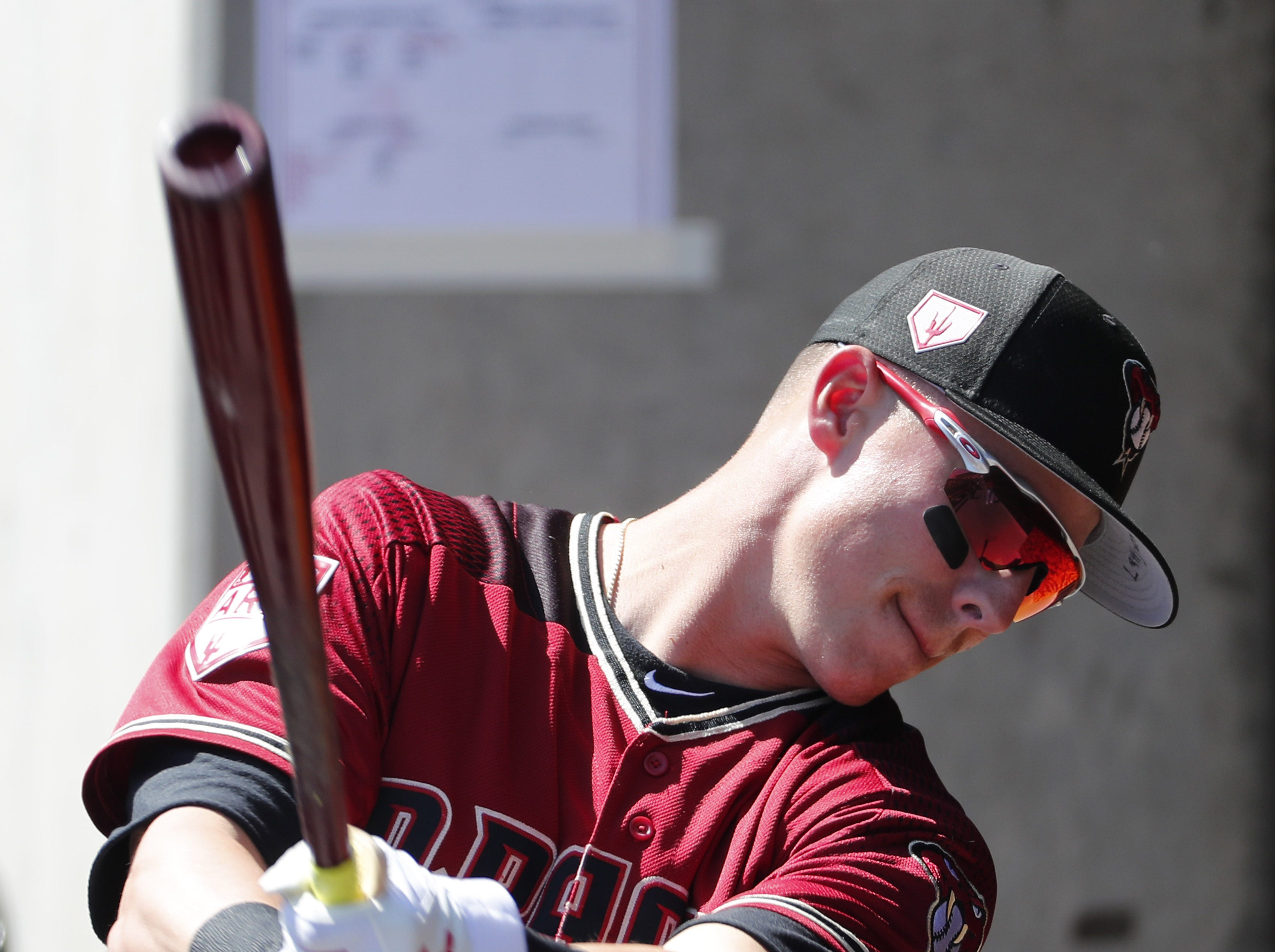 Arizona Diamondbacks first baseman Jake Lamb (22) prepares to bat against the Milwaukee Brewers during spring training at Salt River Fields at Talking Stick March 24, 2019.