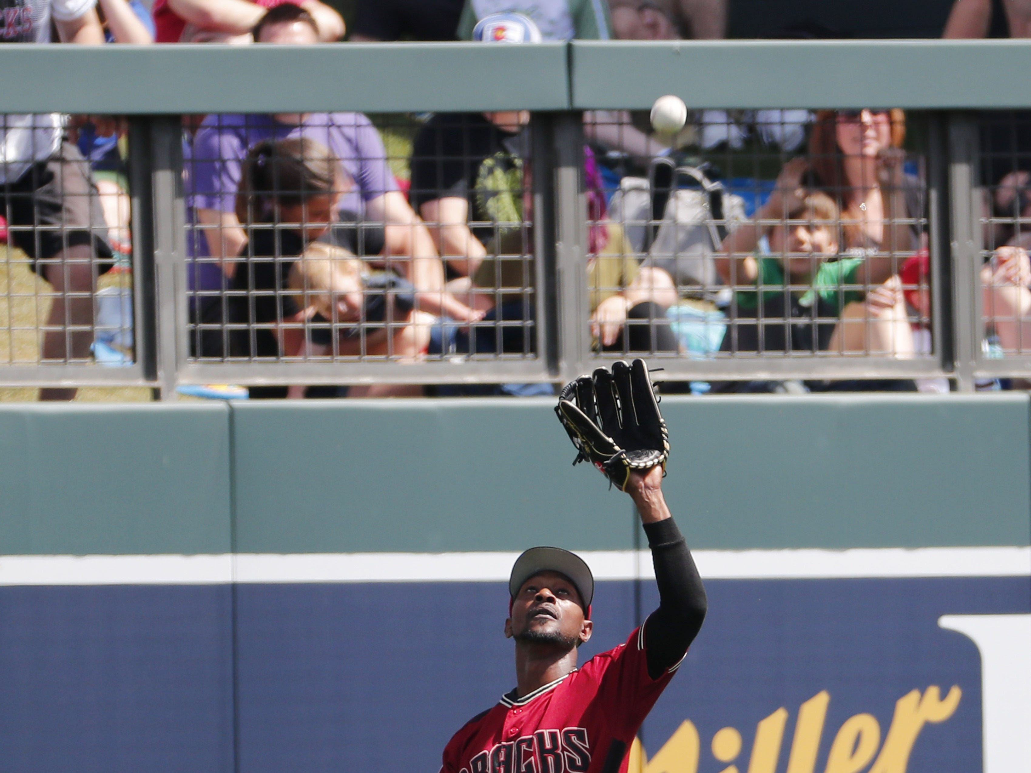 Arizona Diamondbacks center fielder Jarrod Dyson (1) catches a fly ball by Milwaukee Brewers' Lucas Erceg during spring training at Salt River Fields at Talking Stick March 24, 2019.