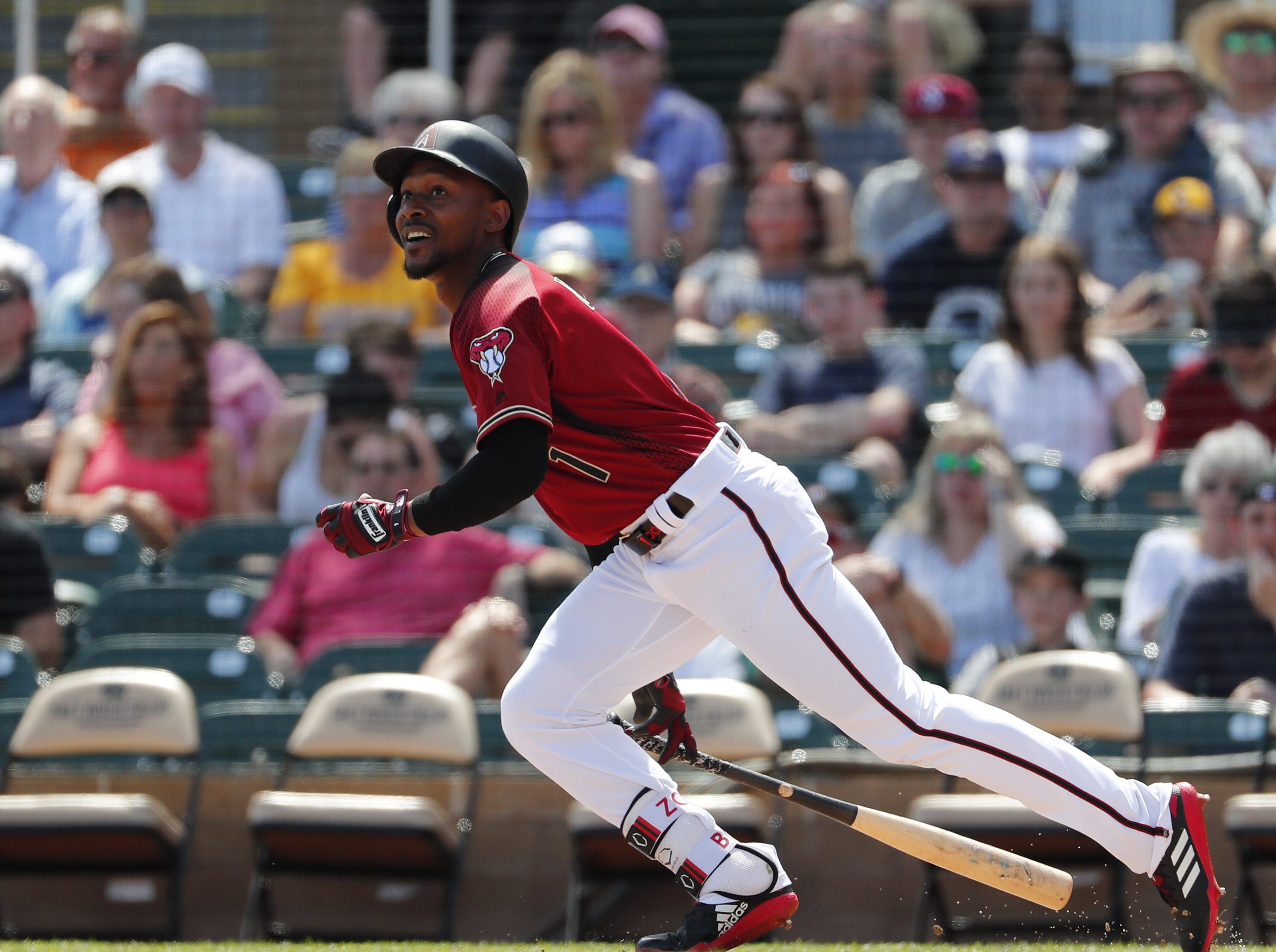 Arizona Diamondbacks center fielder Jarrod Dyson (1) bats against the Milwaukee Brewers during spring training at Salt River Fields at Talking Stick March 24, 2019.