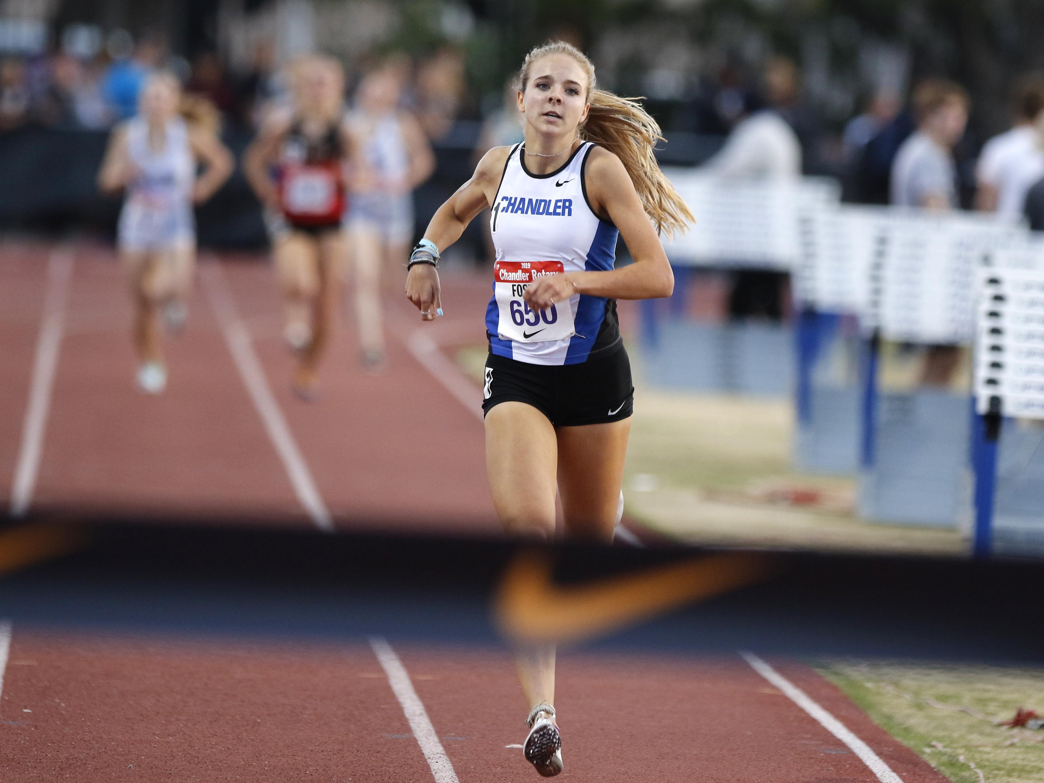 Chandler's Morgan Foster eyes the finish line of the mile run as her competitors are six seconds back during the 79th Annual Nike Chandler Rotary Invitational  March 23, 2019.  Foster won with a time of 4:47.