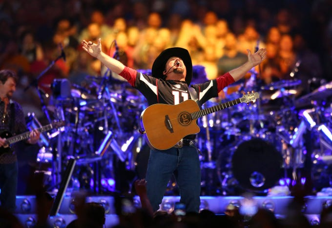 Country music legend Garth Brooks performs to over 75,000 fans, the largest indoor concert crowd ever in Arizona at State Farm Stadium on March 23, 2019 in Glendale, Ariz.