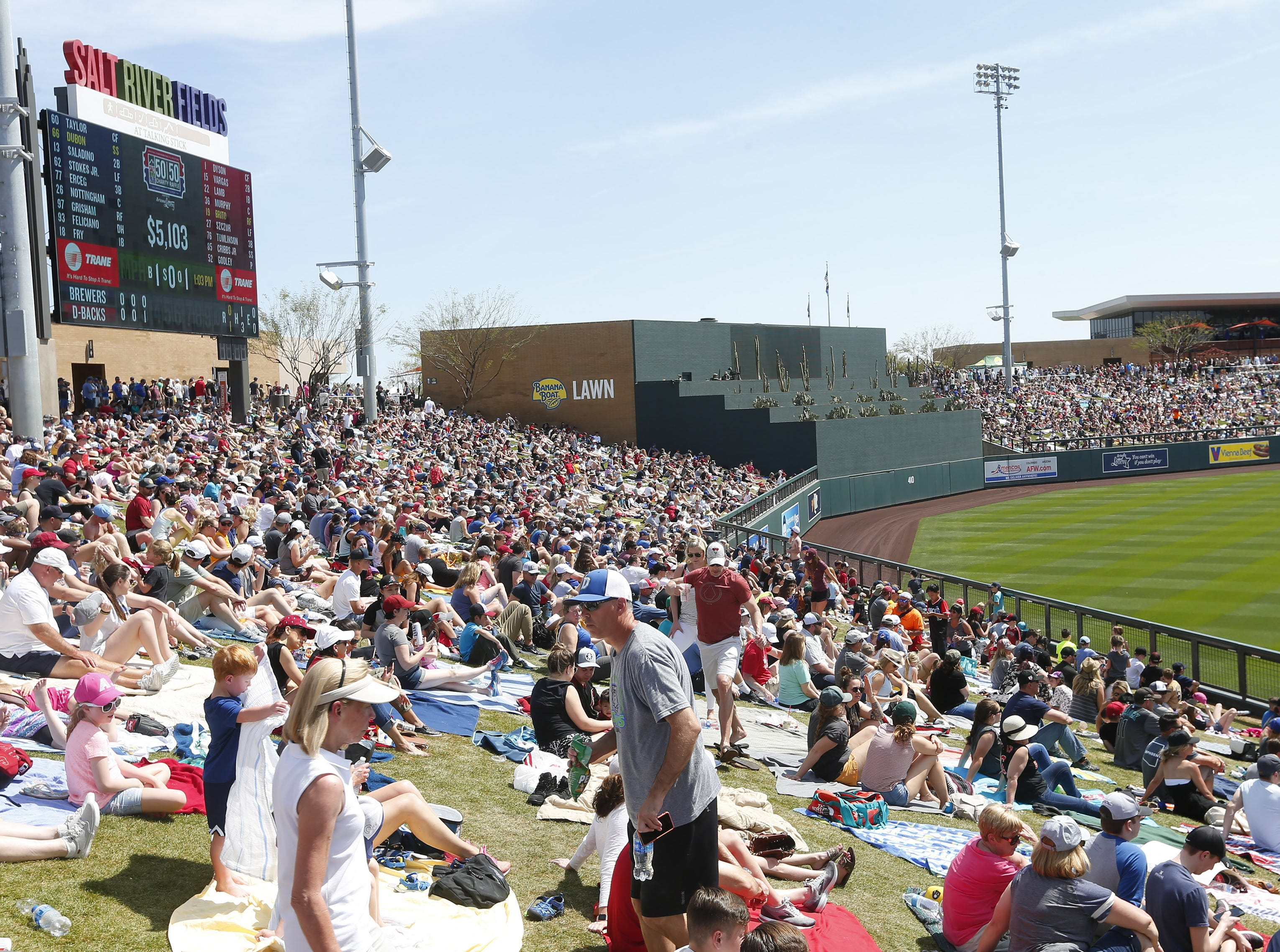 Fans soak up the sun during a spring training game between the Arizona Diamondbacks and the Milwaukee Brewers at Salt River Fields at Talking Stick March 24, 2019.