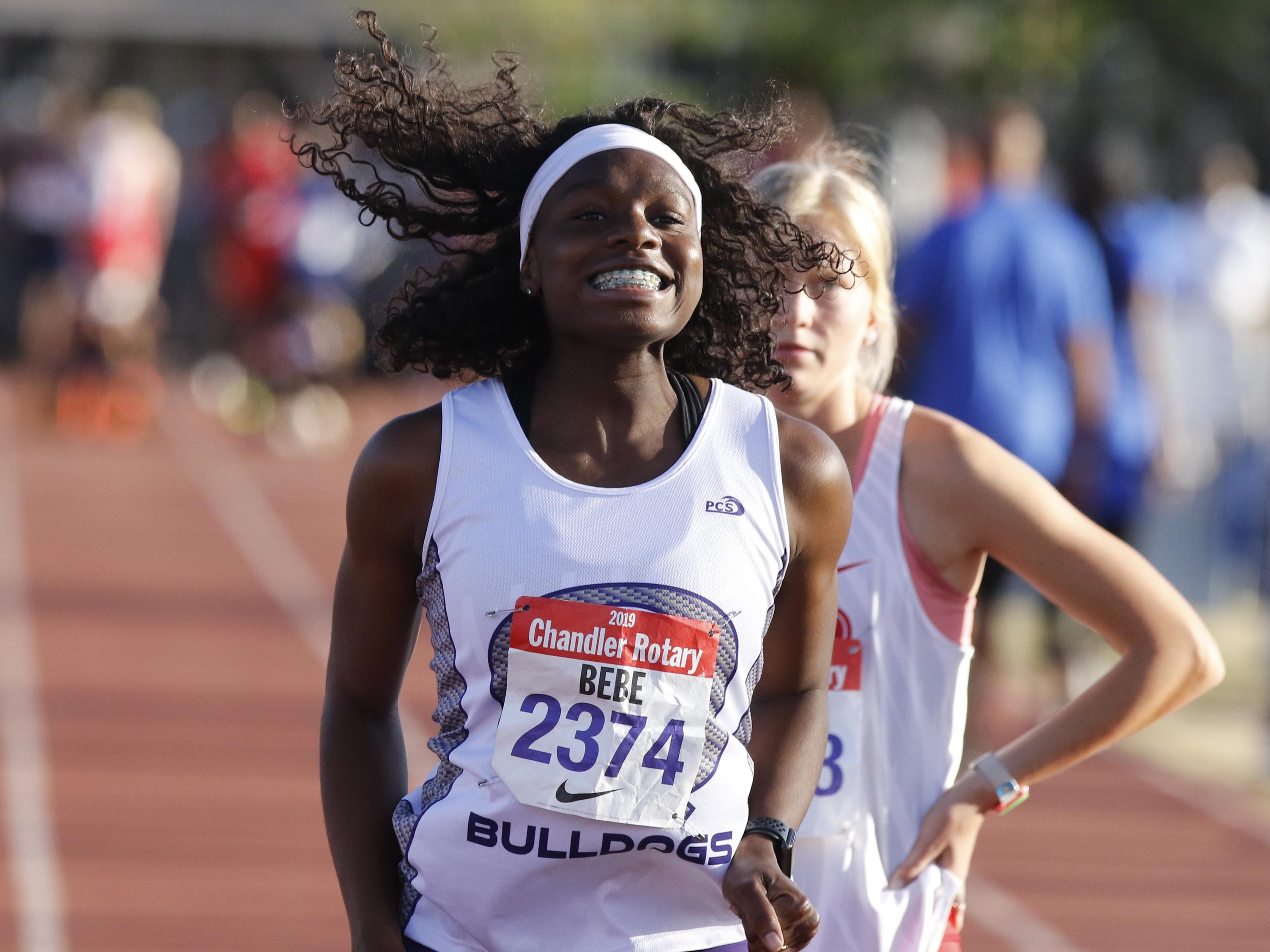 Queen Creek's Myreanna Bebe jumps for joy after seeing her time of 13.81 in the 110 hurdles which she won during the 79th Annual Nike Chandler Rotary Invitational  March 23, 2019.