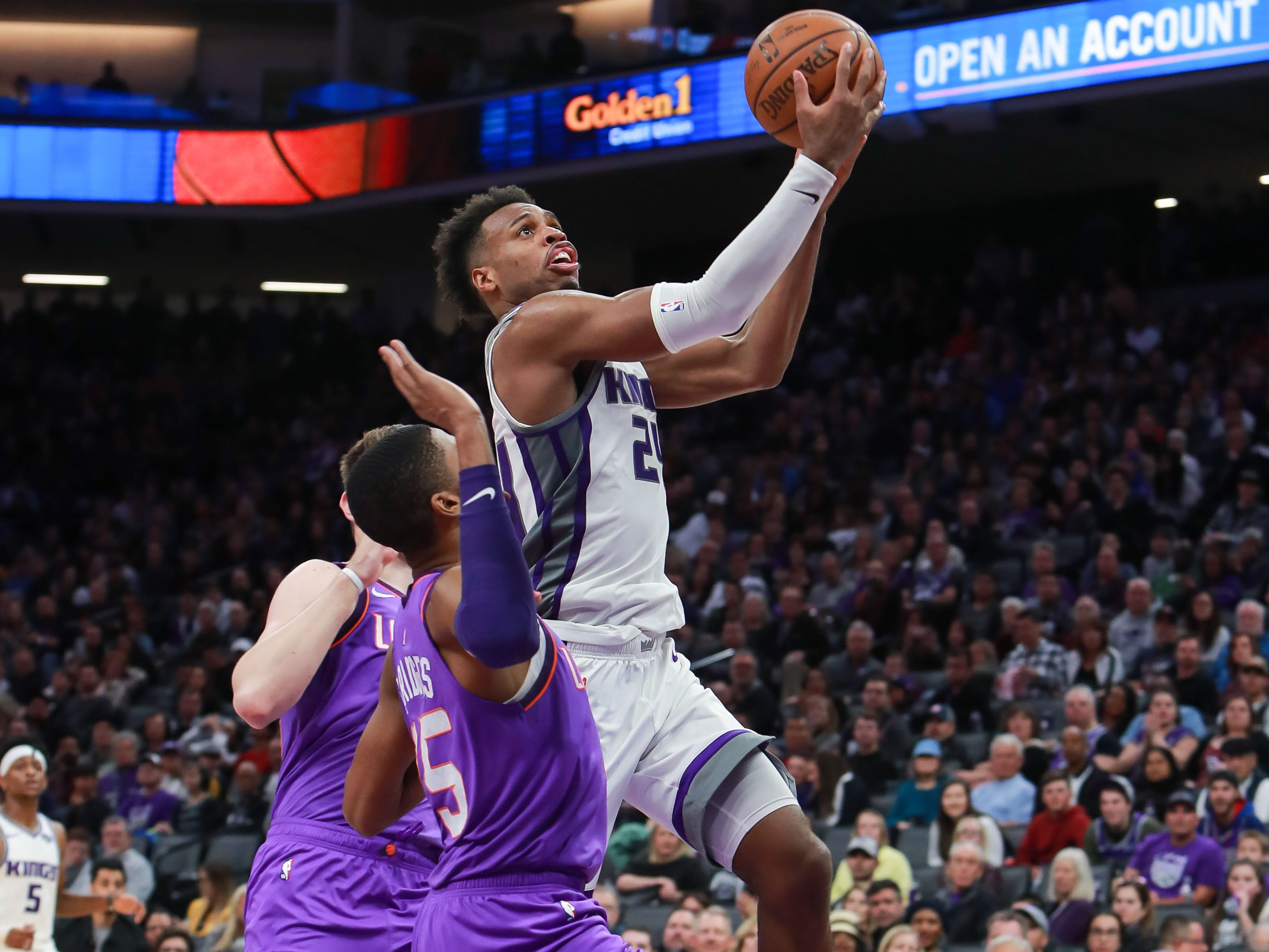 Mar 23, 2019; Sacramento, CA, USA; Sacramento Kings guard Buddy Hield (24) drives to the basket against Phoenix Suns forward Mikal Bridges (25)  during the fourth quarter at Golden 1 Center.