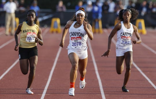 North Canyon's Jadyn Mays lead the 100 meters against Maryvale's  Lucky Matawa Demaih and teammate Jayde Charlton during the 79th Annual Nike Chandler Rotary Invitational  March 23, 2019.
