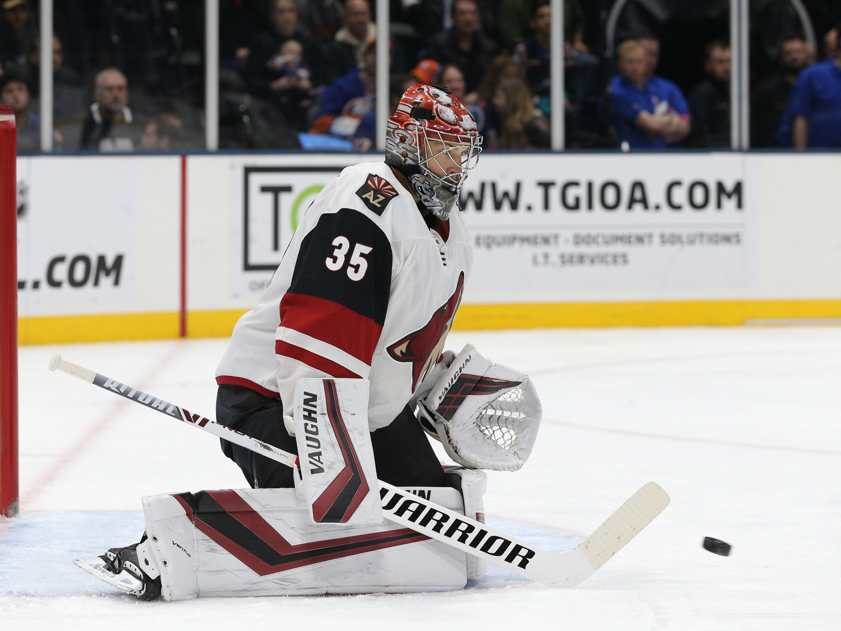 Mar 24, 2019; Uniondale, NY, USA; Arizona Coyotes goalie Darcy Kuemper (35) makes a save against the New York Islanders during the second period at Nassau Veterans Memorial Coliseum. Mandatory Credit: Brad Penner-USA TODAY Sports
