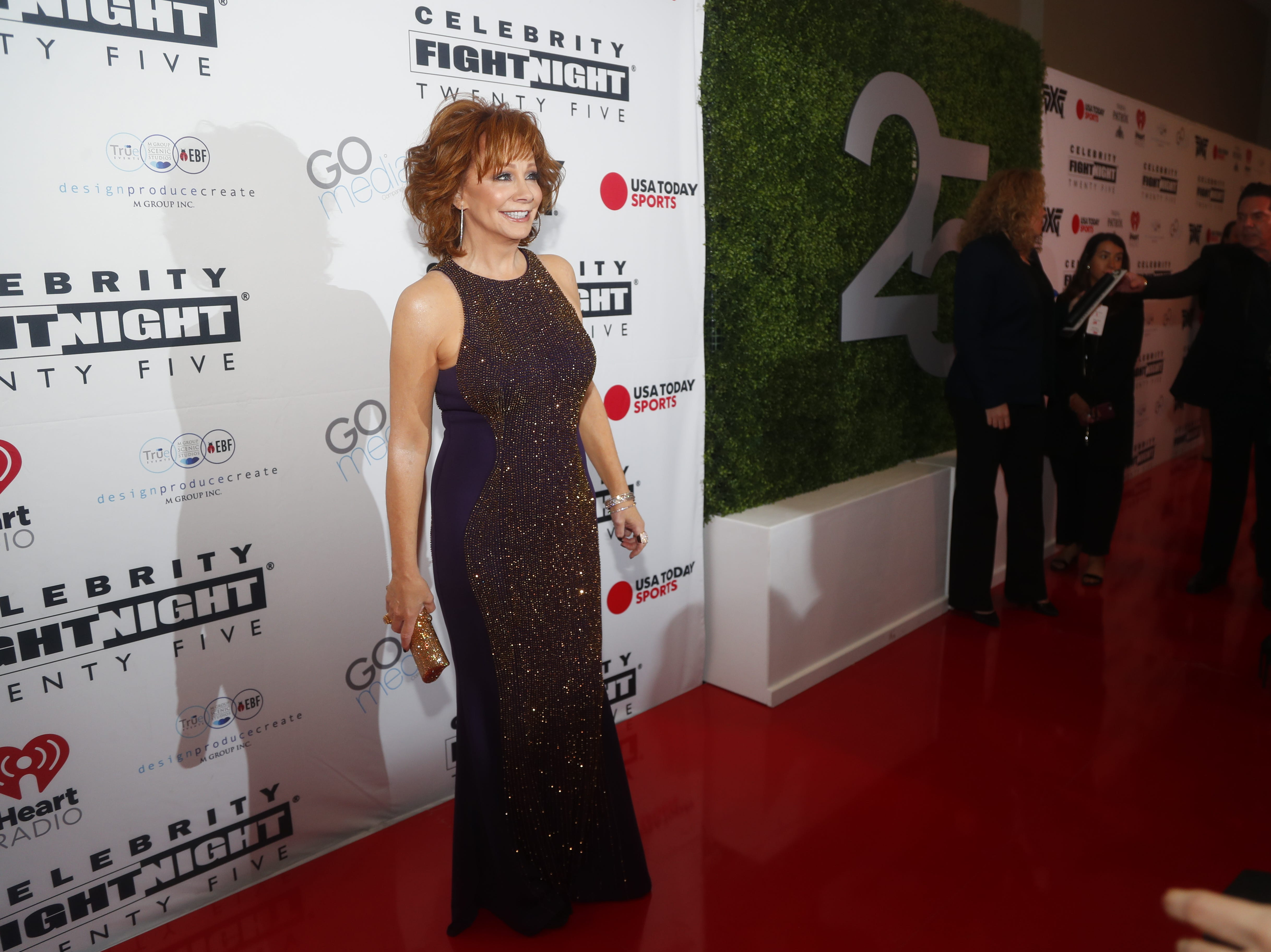 Reba McEntire poses for pictures during the Celebrity Fight Night red carpet in Scottsdale, Ariz., on March 23, 2019.