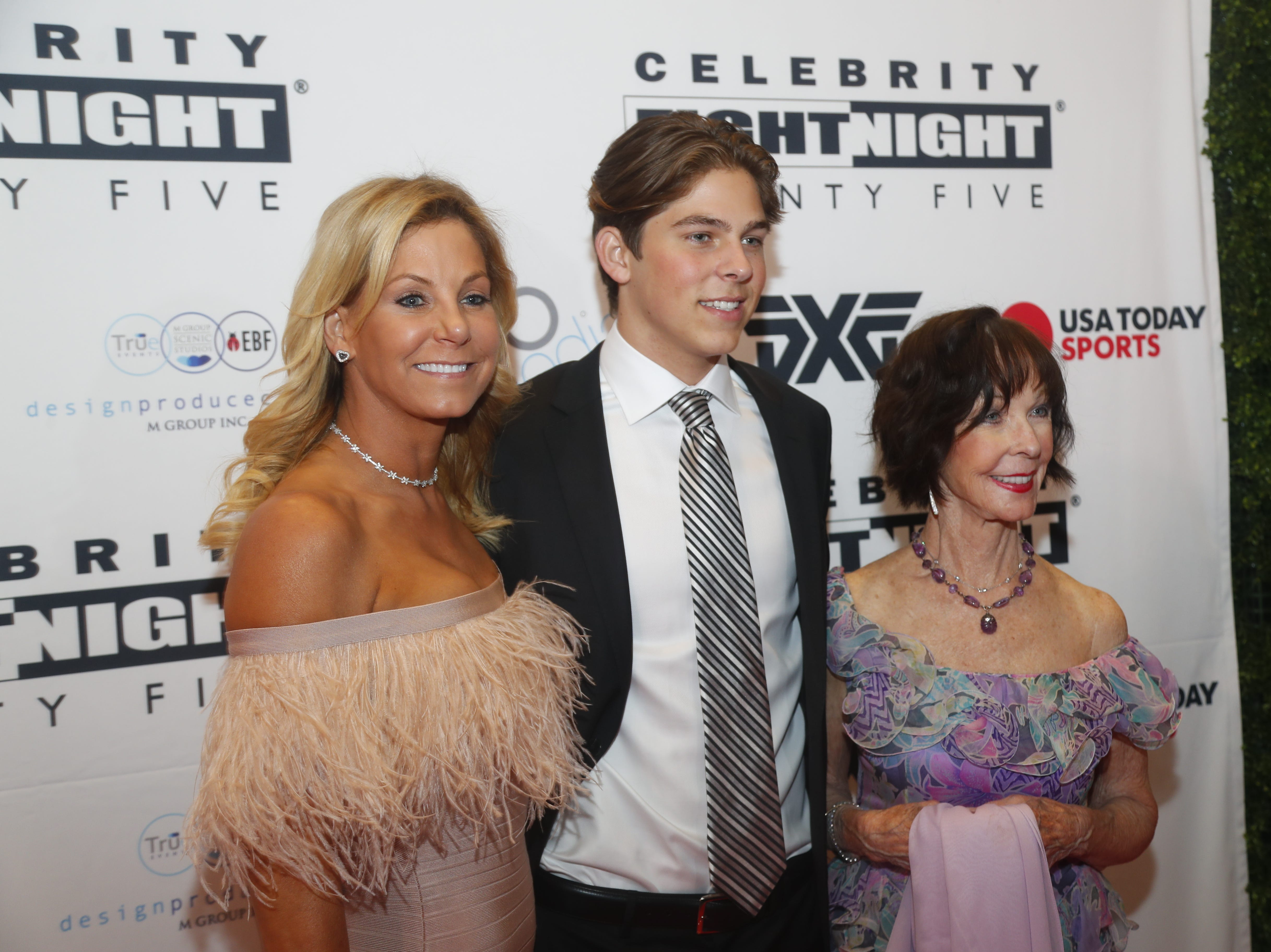 Gunner Gehl poses for pictures during the Celebrity Fight Night red carpet in Scottsdale, Ariz., on March 23, 2019.