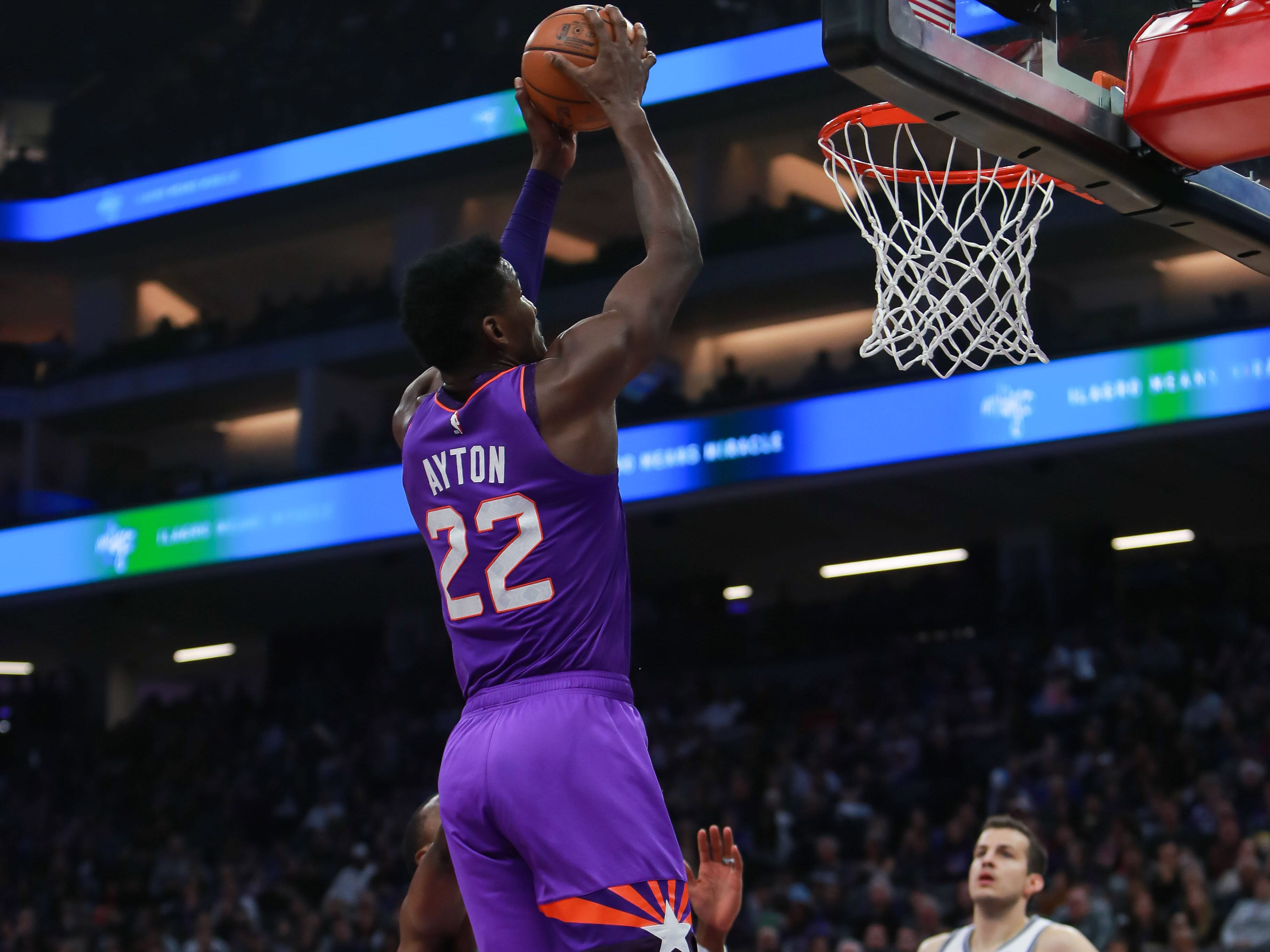 Mar 23, 2019; Sacramento, CA, USA; Phoenix Suns center Deandre Ayton (22) dunks the ball against the Sacramento Kings during the first quarter at Golden 1 Center.
