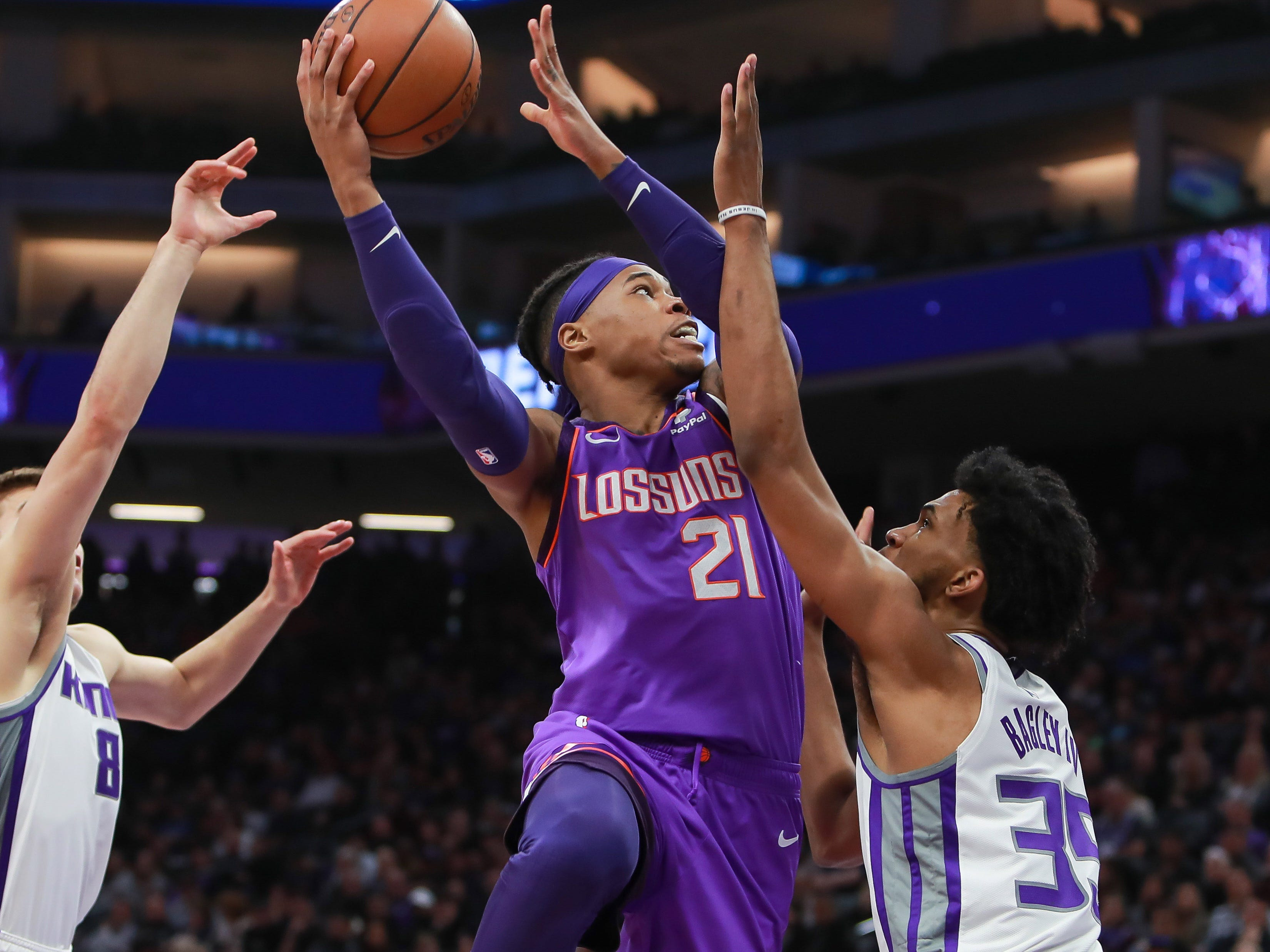 Mar 23, 2019; Sacramento, CA, USA; Phoenix Suns forward Richaun Holmes (21) shoot the ball against Sacramento Kings forward Marvin Bagley III (35) during the first quarter at Golden 1 Center.