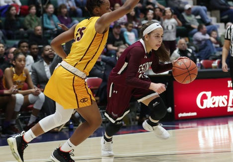 Ossining's Jaida Strippoli (1) drives to the basket against Christ the King during the championship game of the Federation Tournament at the Cool Insuring Arena in Glens Falls March 23, 2019.