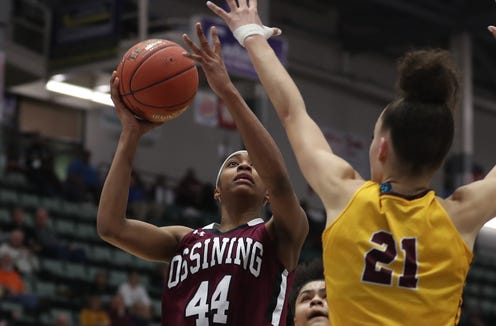 Ossining's Aubrey Griffin (44) puts up a shot against Christ the King during the championship game of the Federation Tournament at the Cool Insuring Arena in Glens Falls March 23, 2019.