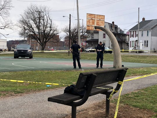York City Police investigate the scene of a shooting Sunday, March 24, 2019, in Williams Park. Dawn J. Sagert photo