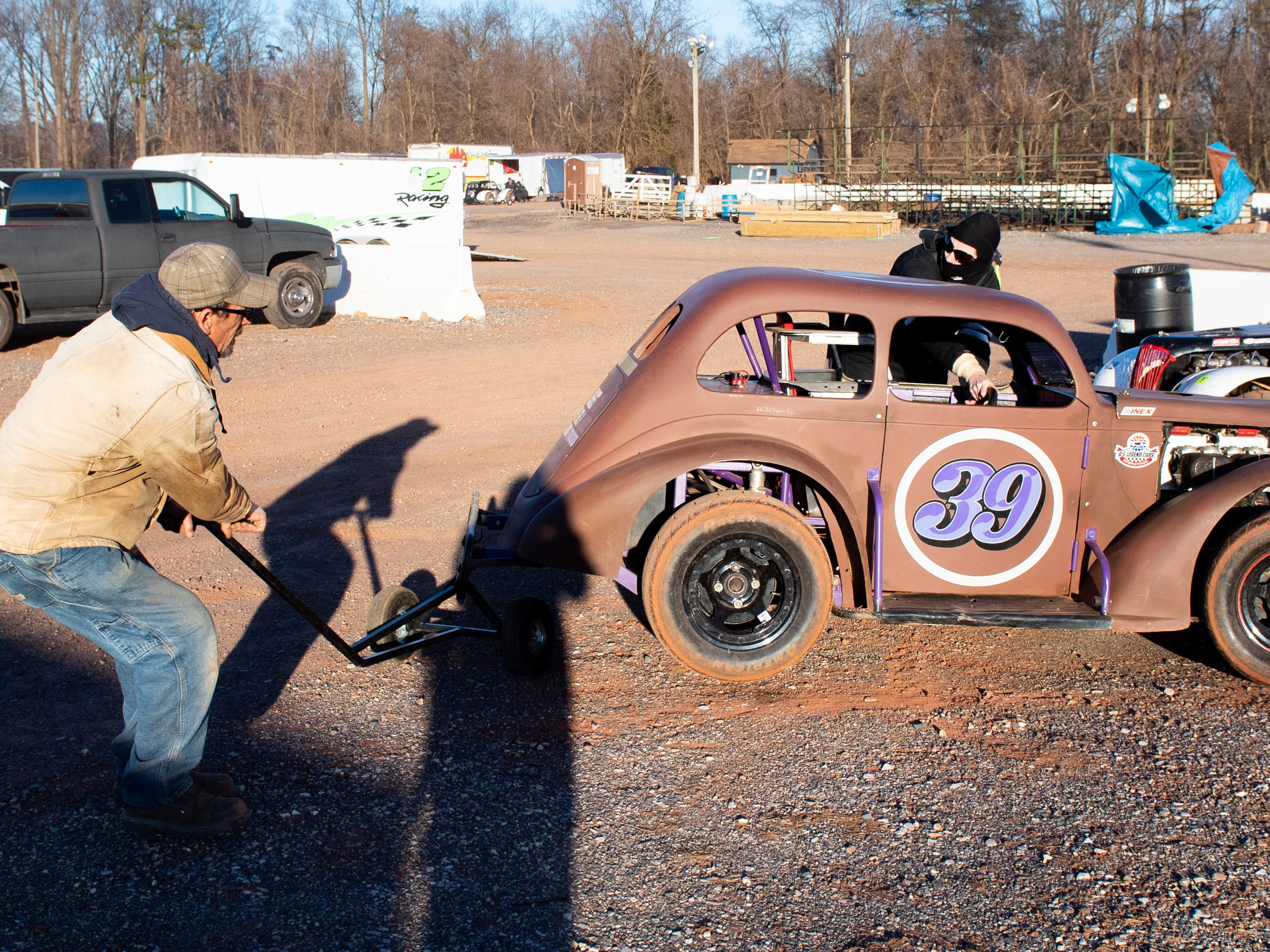 Bonnie Lee and her husband reposition the car during the 2019 season opener at BAPS Motor Speedway, March 23, 2019.