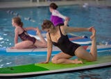 Paddle Board Yoga, YWCA York, combines core strength, balance, serenity of water. The YWCA teamed up with Shank's Mare, who holds warm weather classes