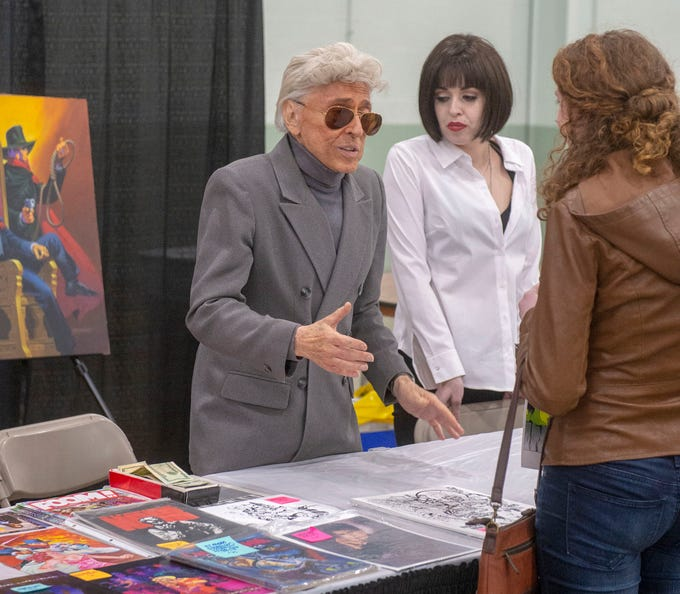 Jim Steranko, one of the prime architects of Marvel Comics and co-creator of Nick Fury, Agent of S.H.I.E.L.D. talks with a fan Saturday at the White Rose Comic Con, which runs through Sunday, March 24, 2019 at Utz Arena of the York Fairgrounds.