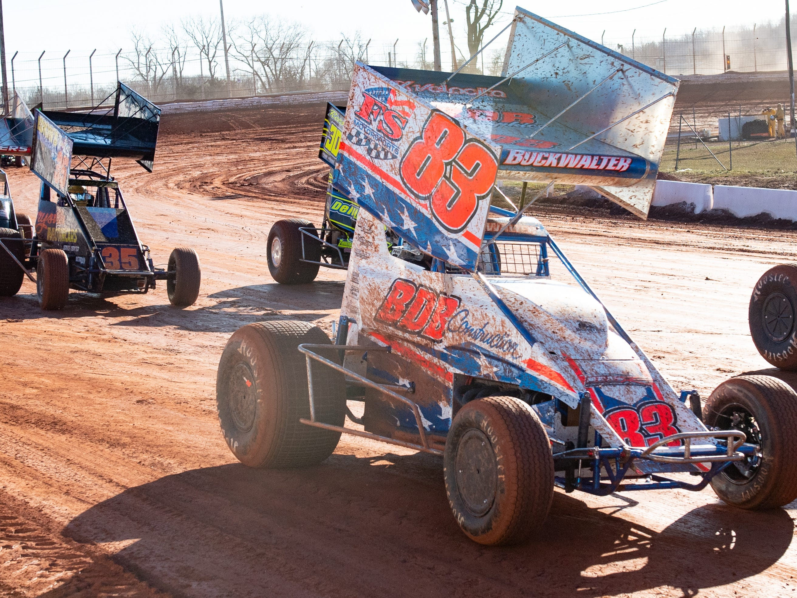 Bruce Buckwalter Jr., driving car #83, is in the middle of the pack during the Super Sportsman race at BAPS Motor Speedway, March 23, 2019.
