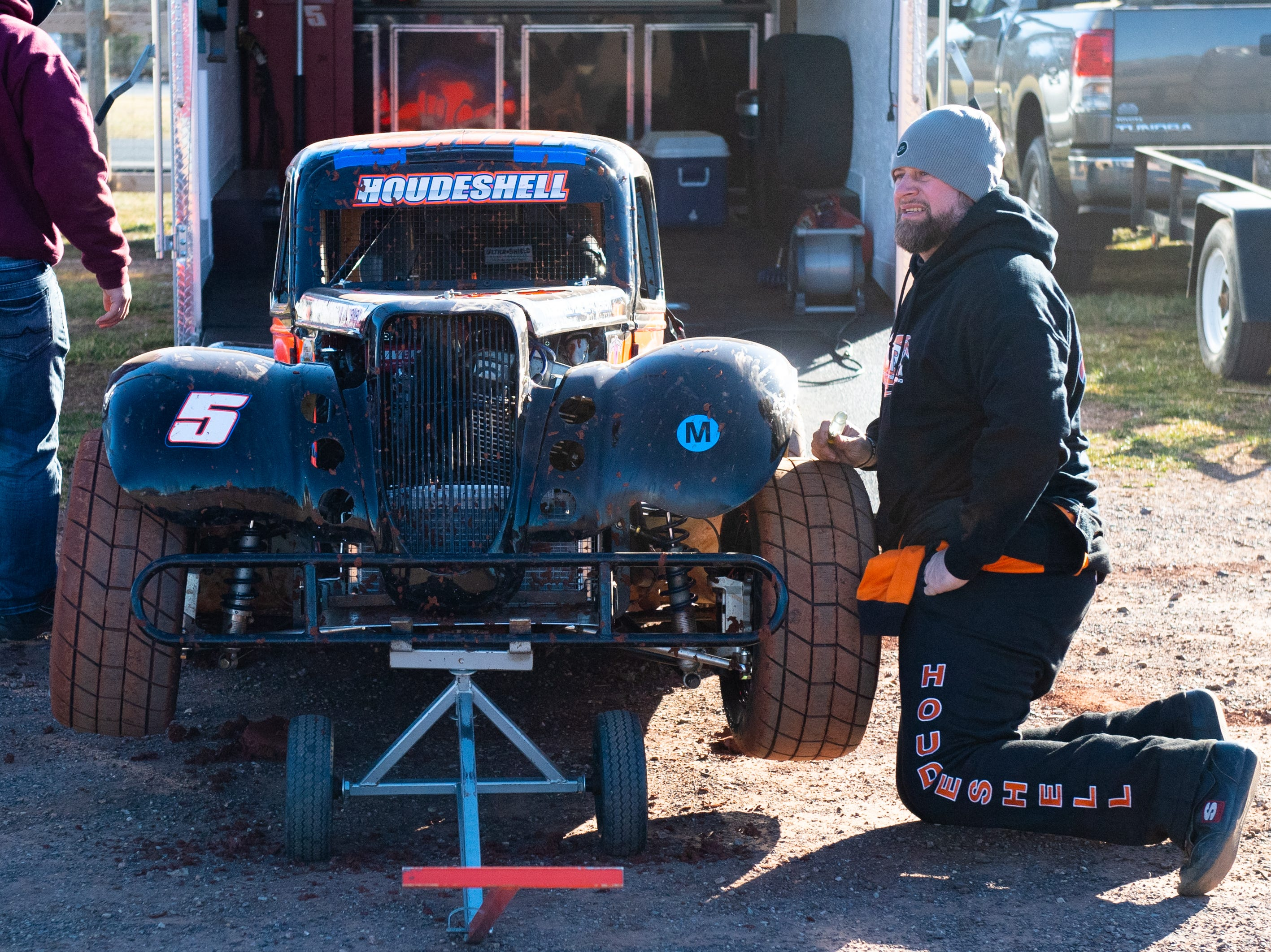 Scott Houdeshell works on his car during the 2019 season opener at BAPS Motor Speedway, March 23, 2019.