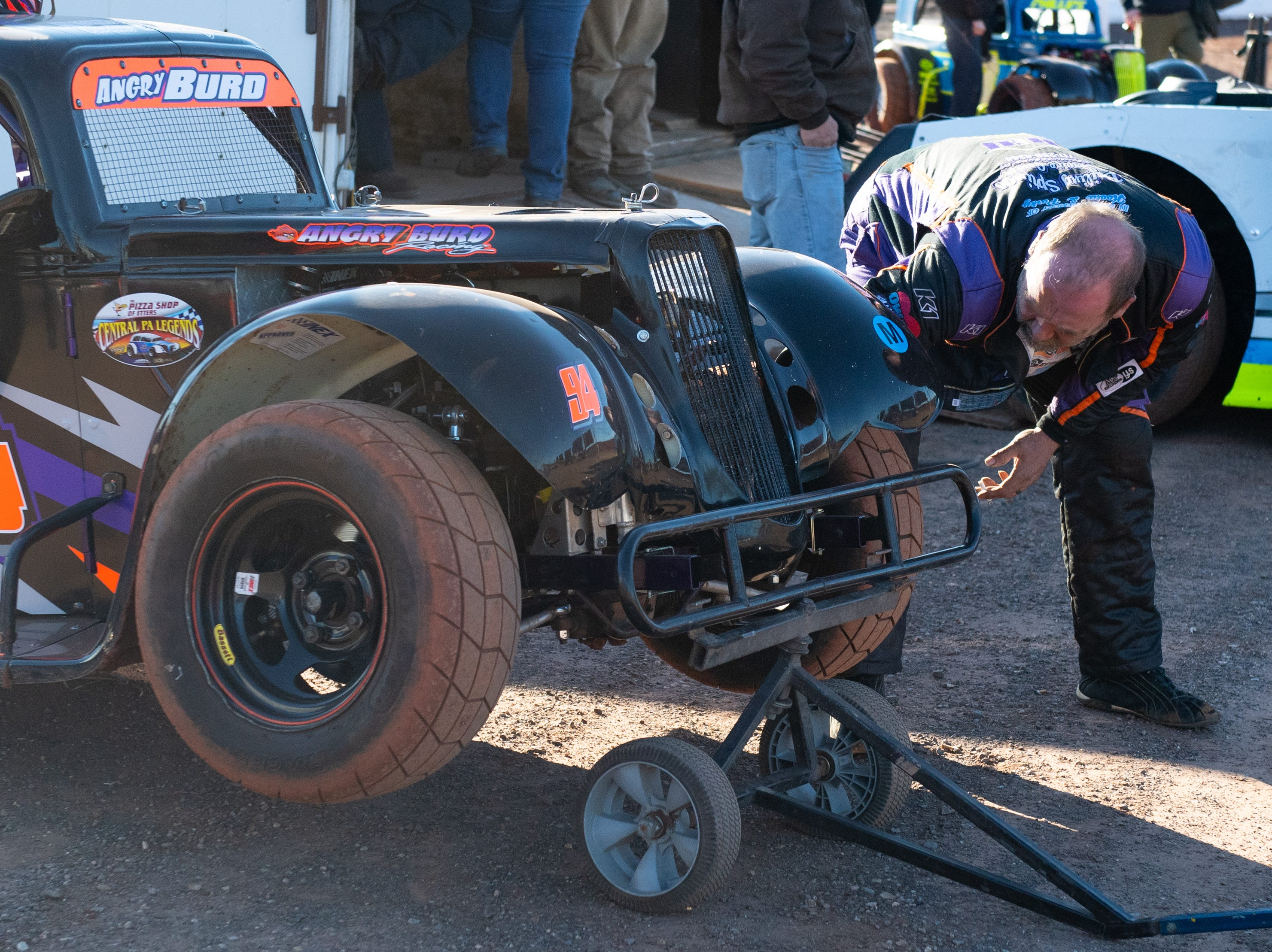 Greg Burd secures his wheels during the 2019 season opener at BAPS Motor Speedway, March 23, 2019.