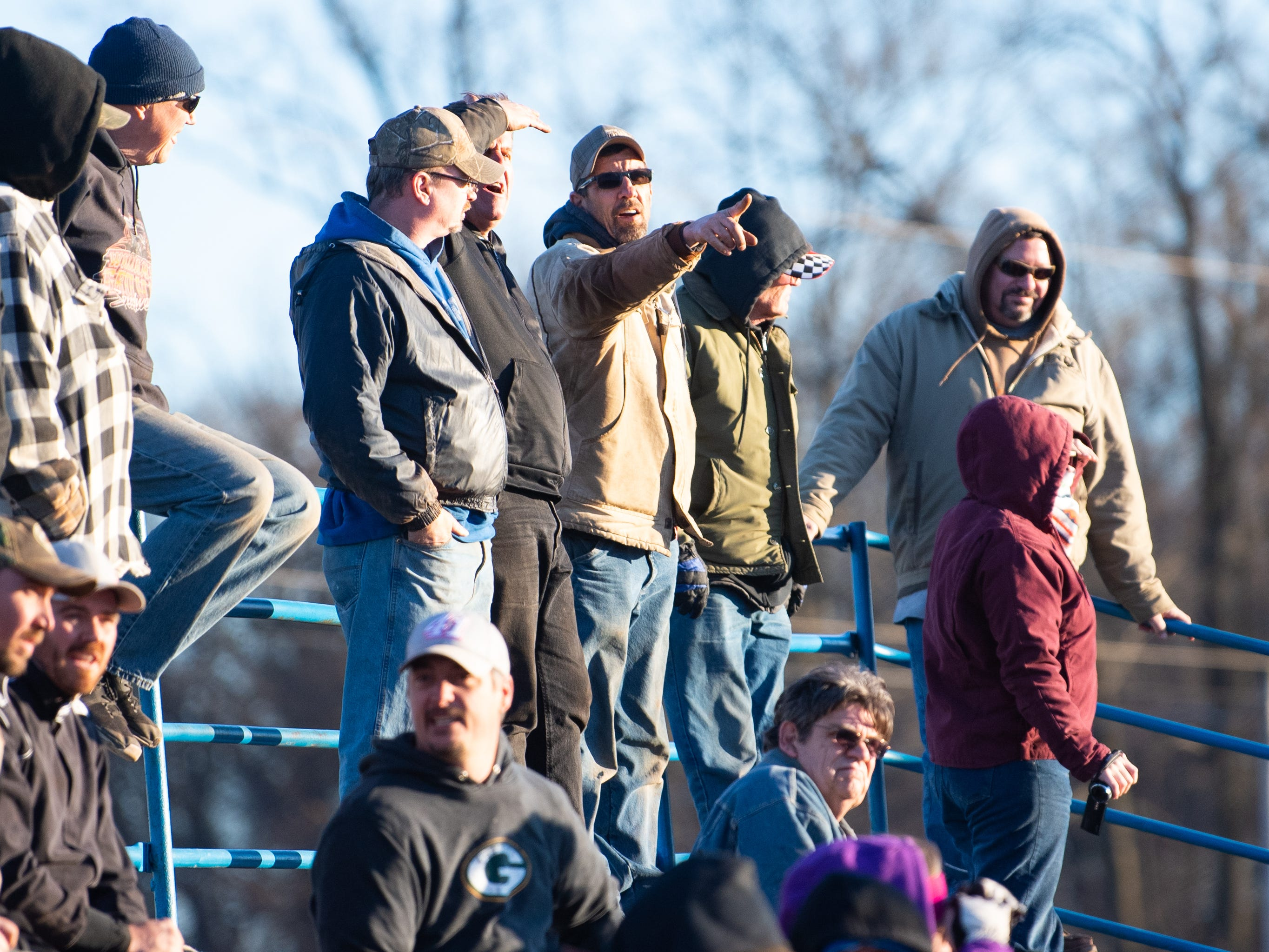 Spectators point out their favorite racers during the 2019 season opener at BAPS Motor Speedway, March 23, 2019.