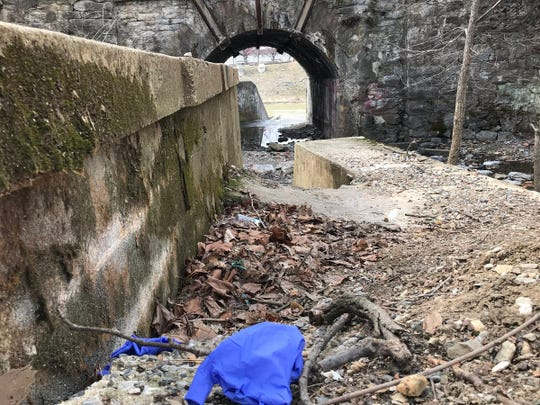 What appear to be fresh surgical gloves at the scene near the Rail Trail and Kings Mill Road in York where the body of Jared Chenowith was found Saturday afternoon.