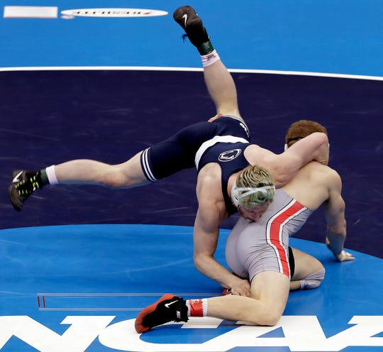 Ohio State's Kollin Moore tries to escape from Penn State's Bo Nickal in their 197-pound match in the finals of the NCAA wrestling championships Saturday. Nickal won the match.