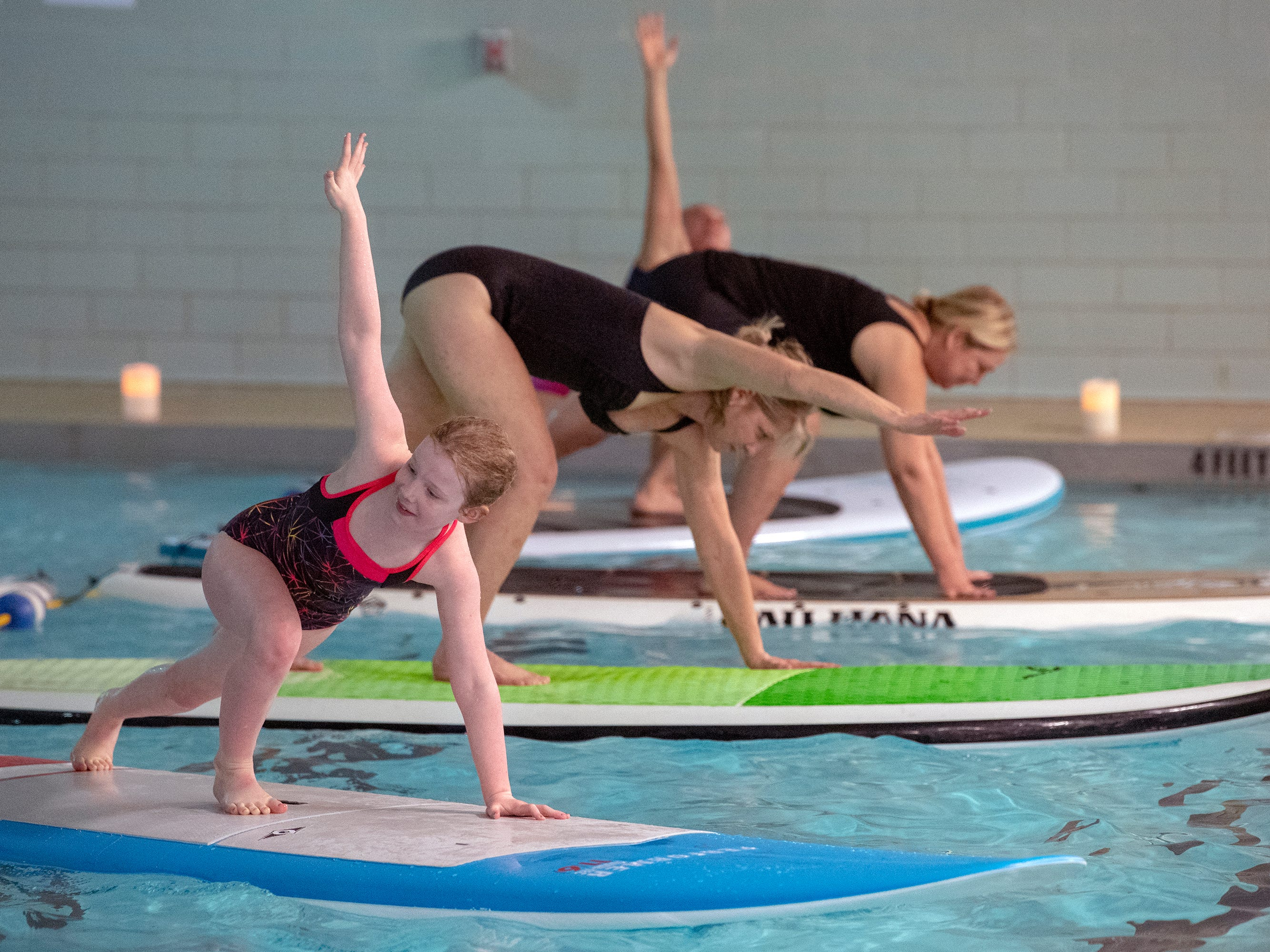 Marlowe Given, age 8 of York, at left, took the class with her mother Liz. The YWCA York is offering a Paddle Board Yoga Class in their pool for the first time. The class is offered on the open water by Shank's Mare in warmer weather.