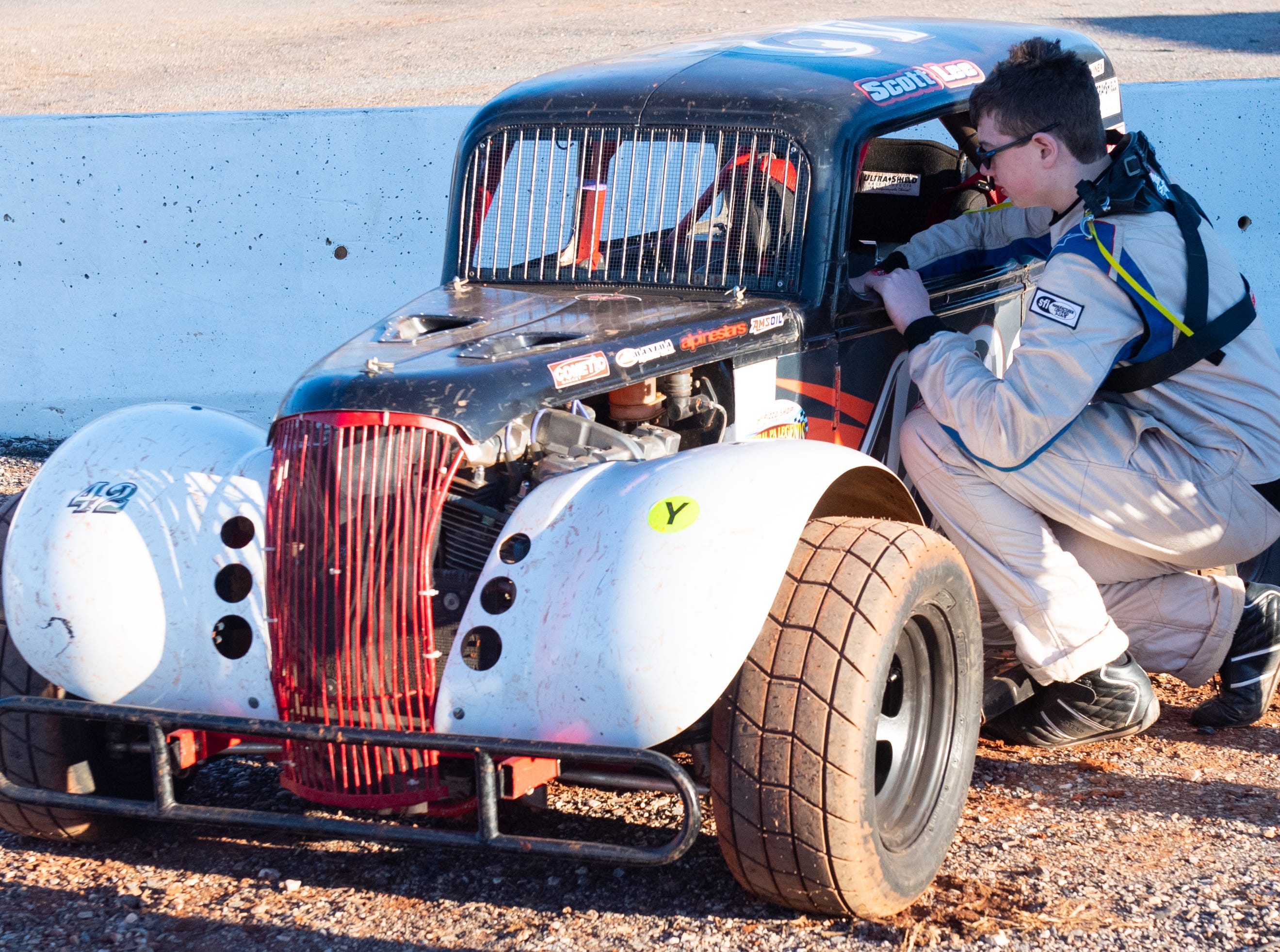 Scott Lee checks his vehicle before the race in the 2019 season opener at BAPS Motor Speedway, March 23, 2019.