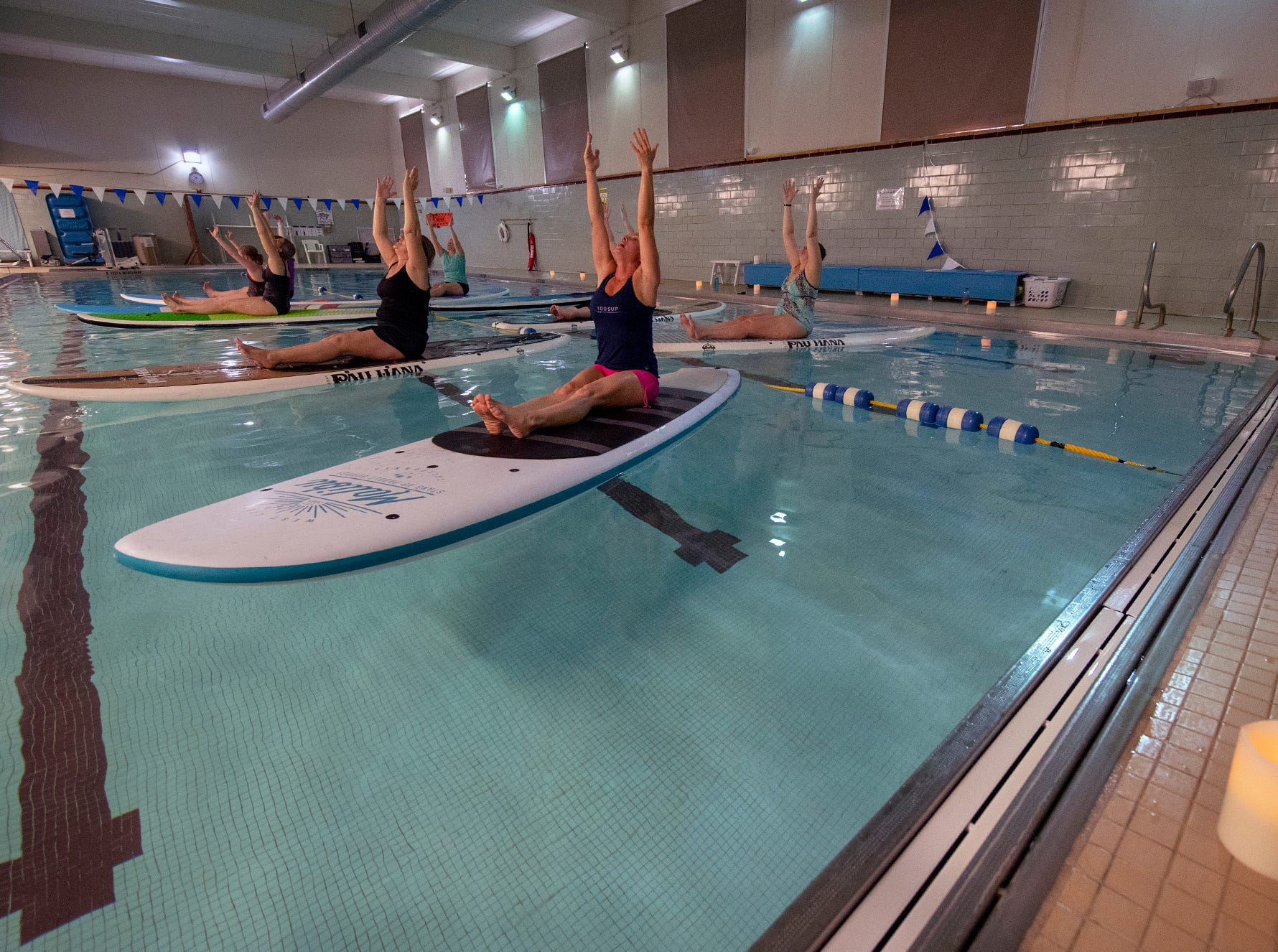 The YWCA York is offering a Paddle Board Yoga Class in their pool for the first time. Shank's Mare provided the boards. The class is offered on the open water in warmer weather.
